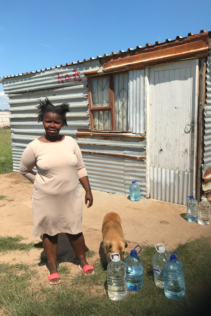 25 March 2020: Ntombovuyo Salman, who lives in Nkanini outside Makhanda, collects water from an exposed water pipe each time the few taps in the area run dry.