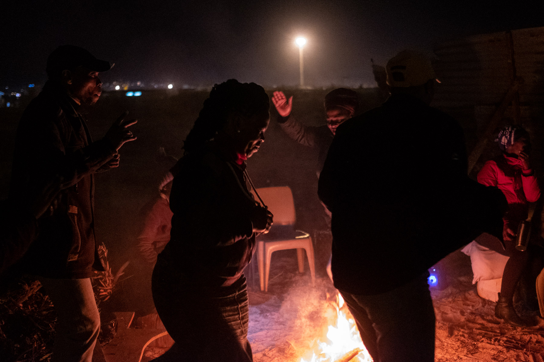 16 April 2020: Residents make the most of the evening and dance to maskandi music as they prepare for another night of sleeping outside.