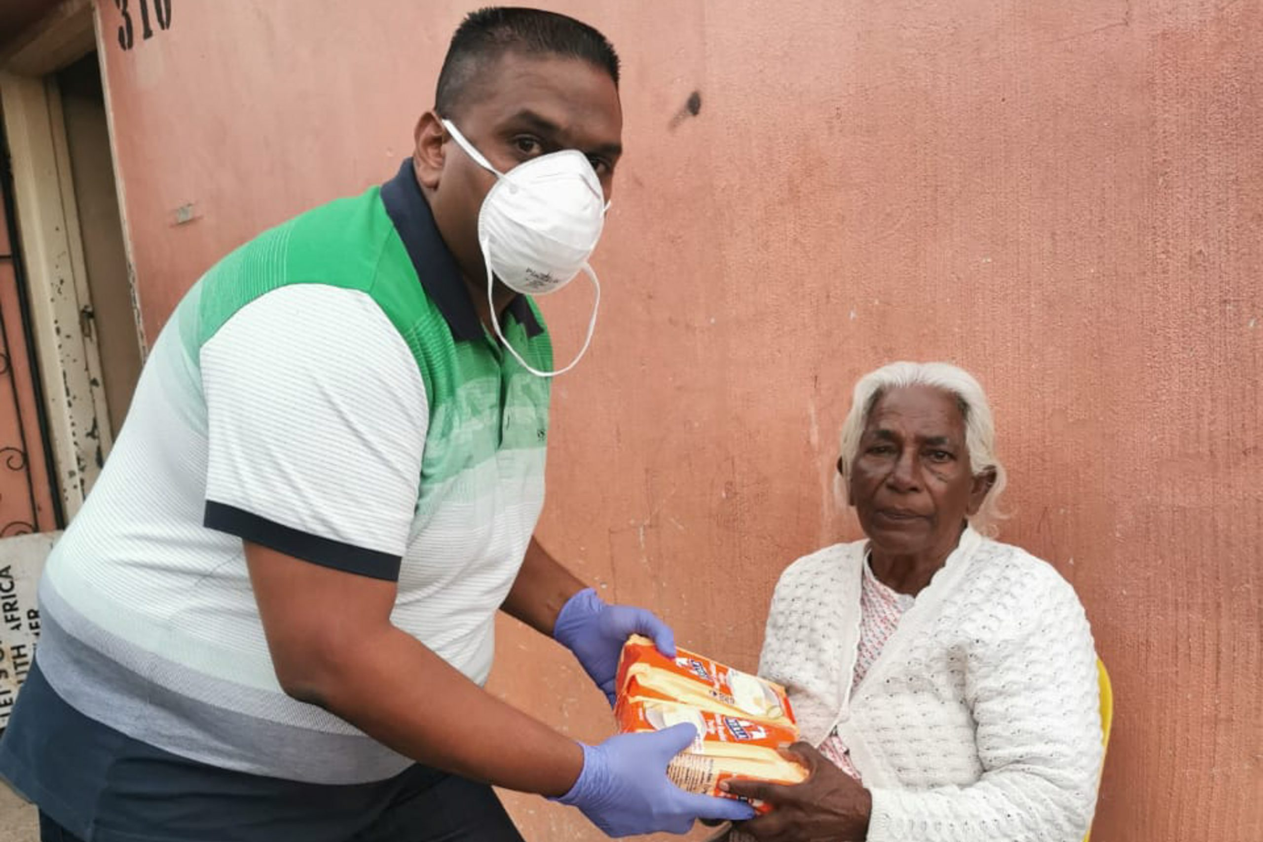 Undated: Chatsworth volunteer Brandon Pillay delivering food to pensioner Allama Pillay.