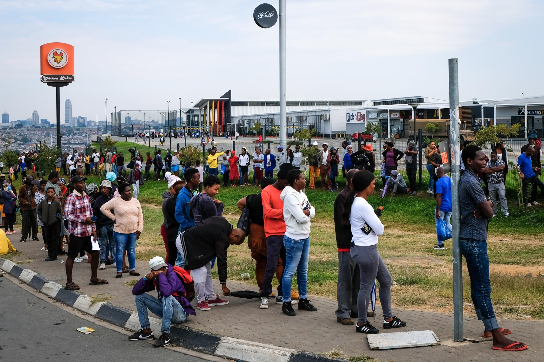 1 April 2020: Residents queue outside the Alex mall.