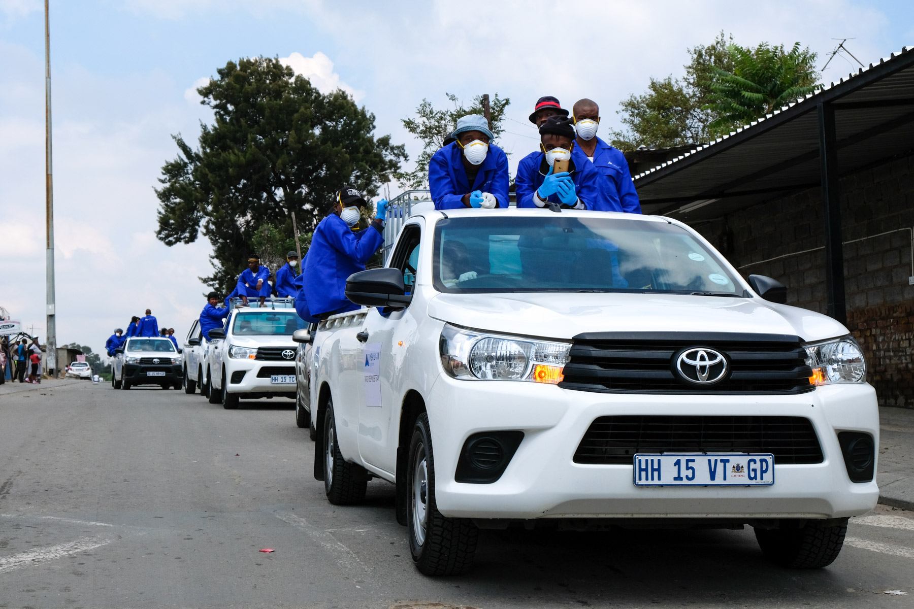 2 April 2020: Meridian Hygiene sanitation workers make their way through Alex.