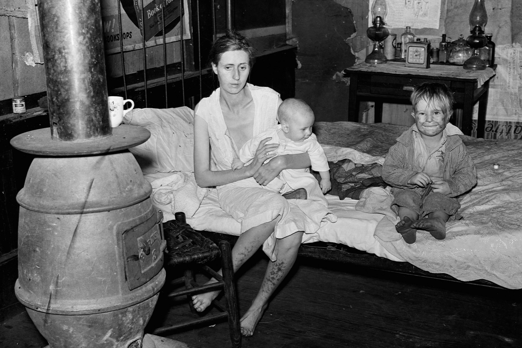 1938: The wife and two children of an unemployed mine worker living in an abandoned mining town in Marine, West Virginia. She is suffering from both tuberculosis and syphilis. (Photograph by Corbis/ Corbis via Getty Images)
