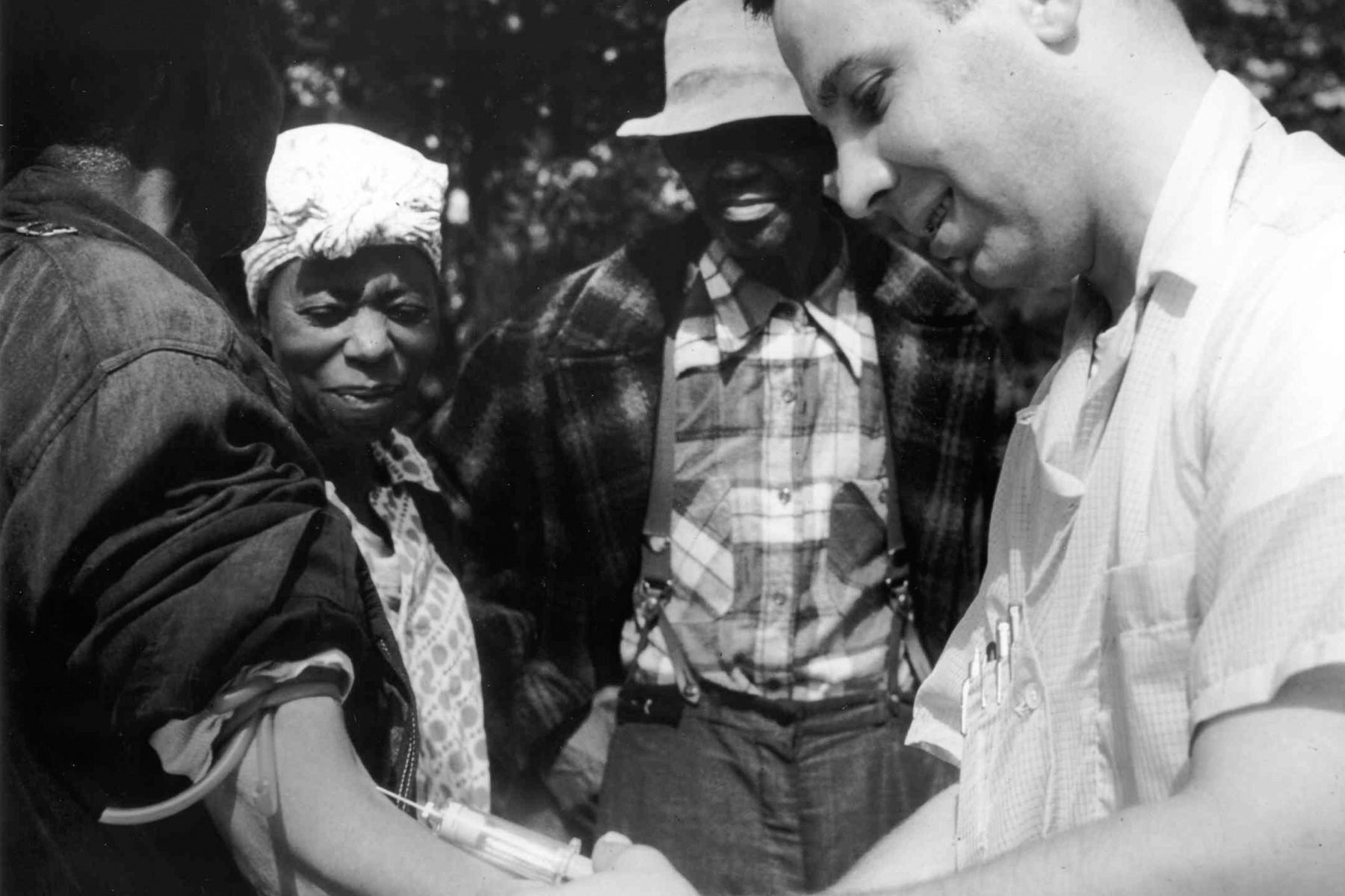 1932: A doctor draws blood from a patient as part of the Tuskegee Syphilis Study. (Photography by Wikimedia Commons/ US National Archive)