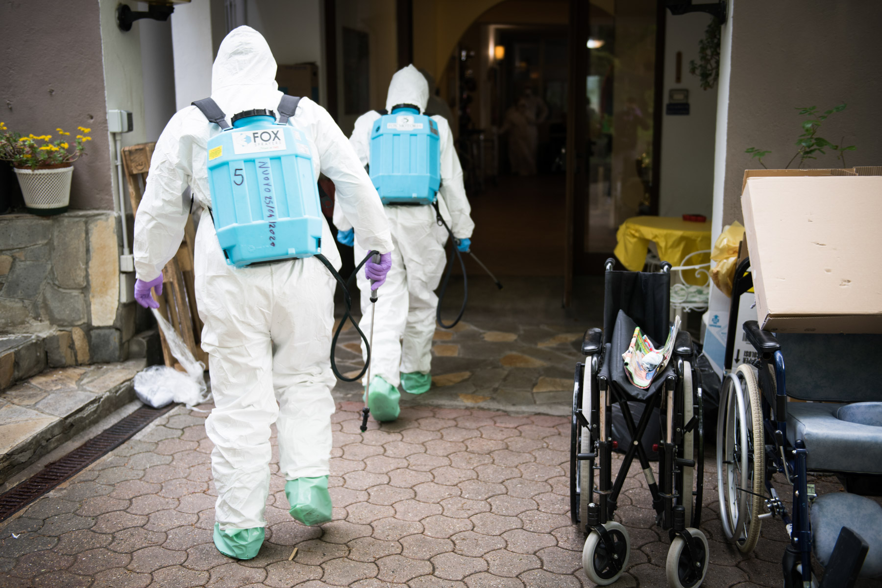 30 April 2020: Italian soldiers disinfect a home for the elderly in Turin, Italy, during the Covid-19 pandemic. (Photograph by Stefano Guidi/ Getty Images)