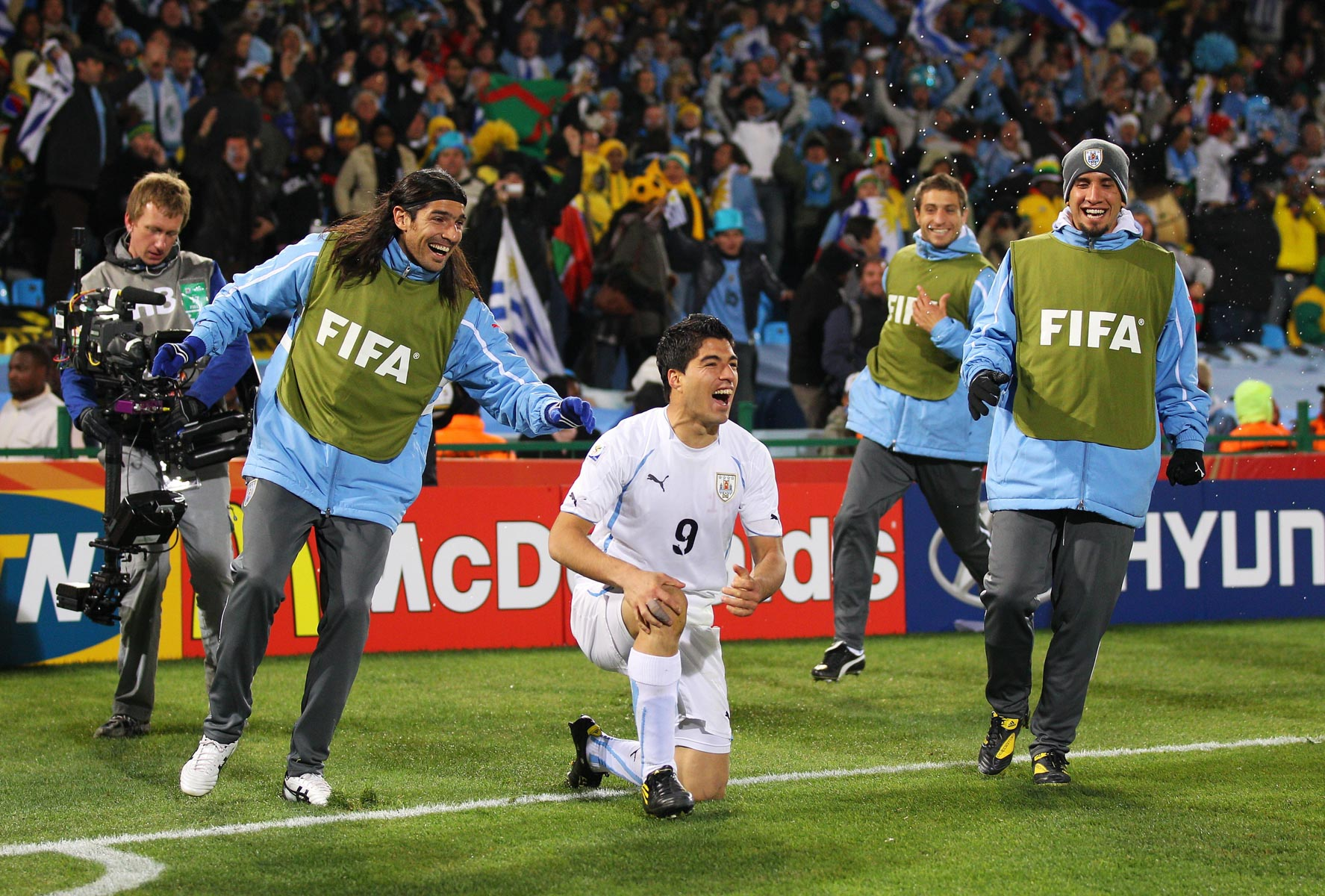 16 June 2010: Luis Suarez celebrates Uruguay's victory with his teammates at Loftus Versfeld. (Photograph by Cameron Spencer/ Getty Images)