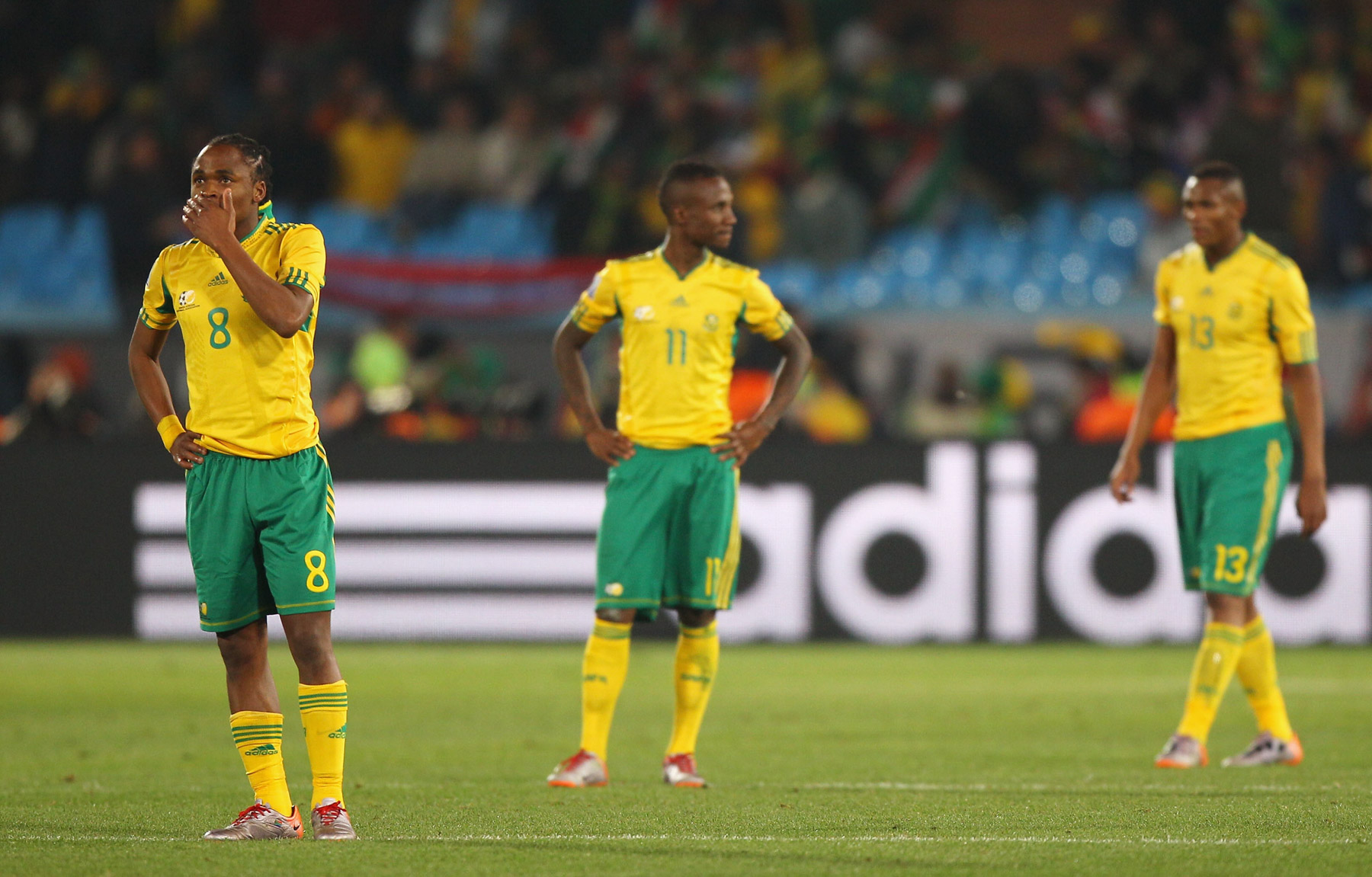 16 June 2010: South Africa's Siphiwe Tshabalala, Teko Modise and Kagisho Dikgacoi look dejected after Bafana's defeat to Uruguay. (Photograph by Michael Steele/ Getty Images)