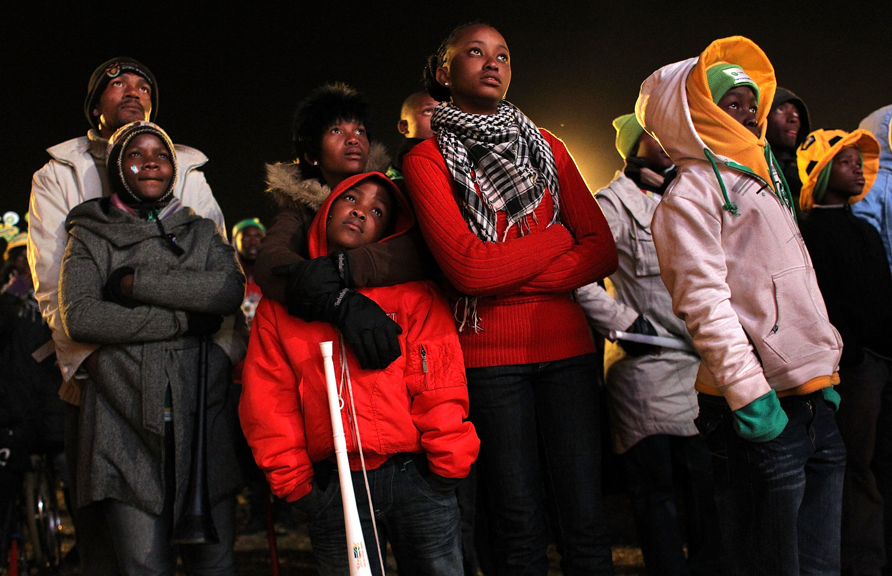 16 June 2010: Spectators at a Soweto fan park watch as Uruguay defeats South Africa 3-0. (Photograph by John Moore/ Getty Images)