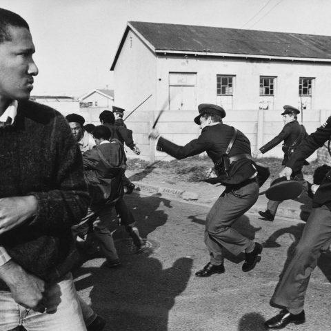 1985: South African police officers charge a group of United Democratic Front demonstrators as they march to Pollsmoor Prison in Cape Town in an attempt to free political prisoners. (Photograph by Gideon Mendel/ Corbis via Getty Images)