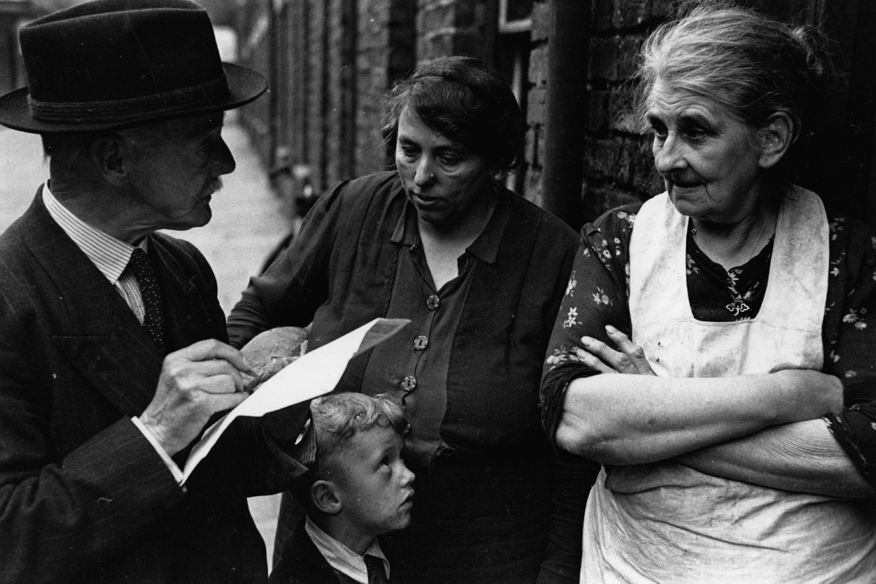 1944: People take part in a doorstep survey about the need for a National Health Service in Britain. (Photograph by Felix Man/ Getty Images)