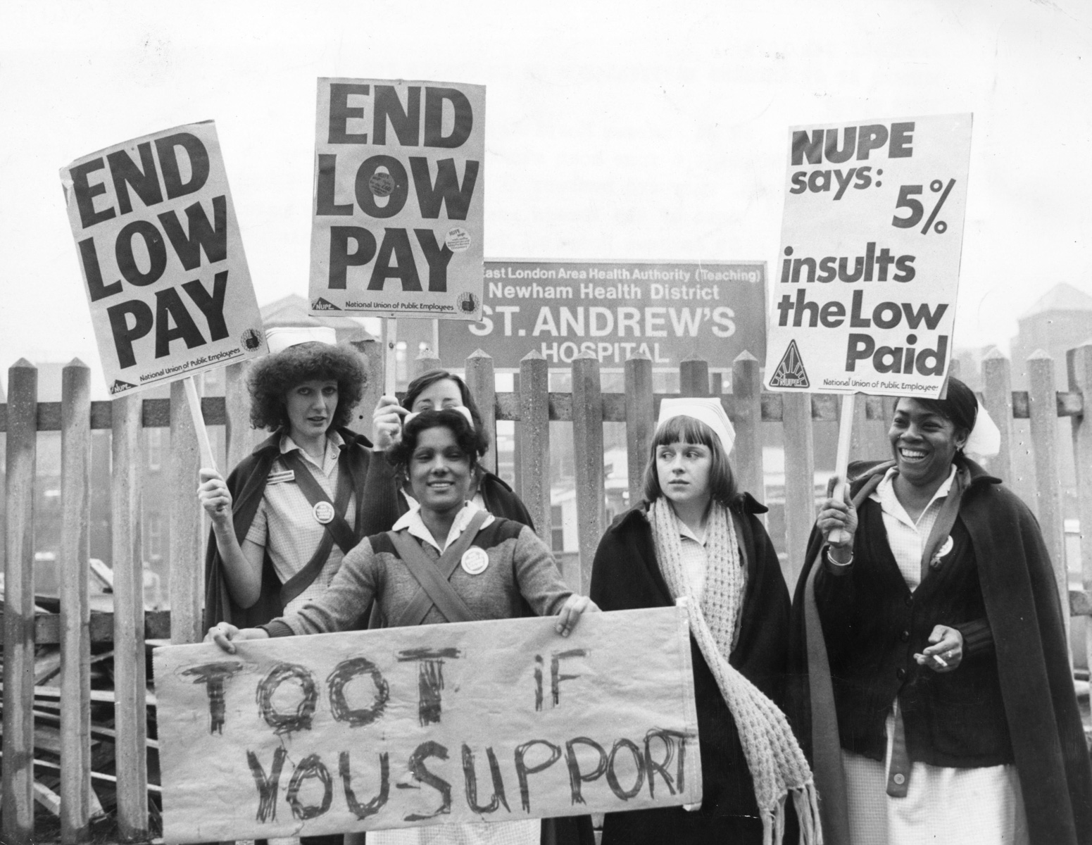 7 February 1979: Members of a union defending a wage claim stand outside St Andrew's hospital in Bow, an area in East London, England. (Photograph by Graham Turner/ Keystone/ Getty Images)
