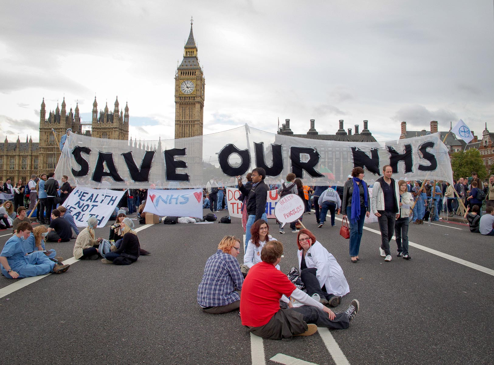 9 October 2011: Activist group UK Uncut and supporters of the National Health Service block the Westminster Bridge in protest against a bill that would make sweeping changes to the health service. It was eventually passed. (Photograph by SM Swenson/ Getty Contributor)