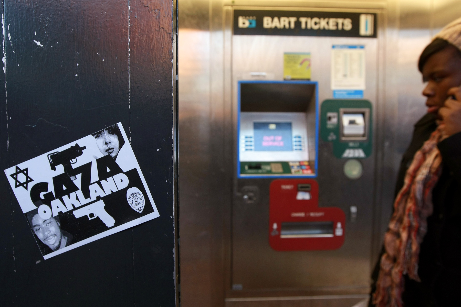 7 January 2009: A sticker with a picture of slain Oscar Grant III on a Bay Area Rapid Transit ticket machine during a demonstration at the Fruitvale station. Grant was killed by a BART police officer. (Photograph by Justin Sullivan/ Getty Images)