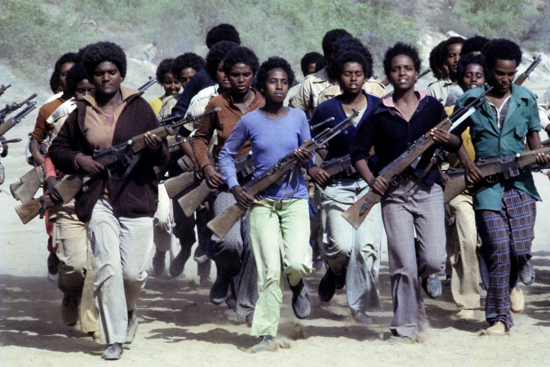 18 June 1978: Young men and women undergo military training at an Eritrean People's Liberation Front camp in the mountains of northern Eritrea in Ethiopia. (Photograph by Alex Bowie/ Getty Images)