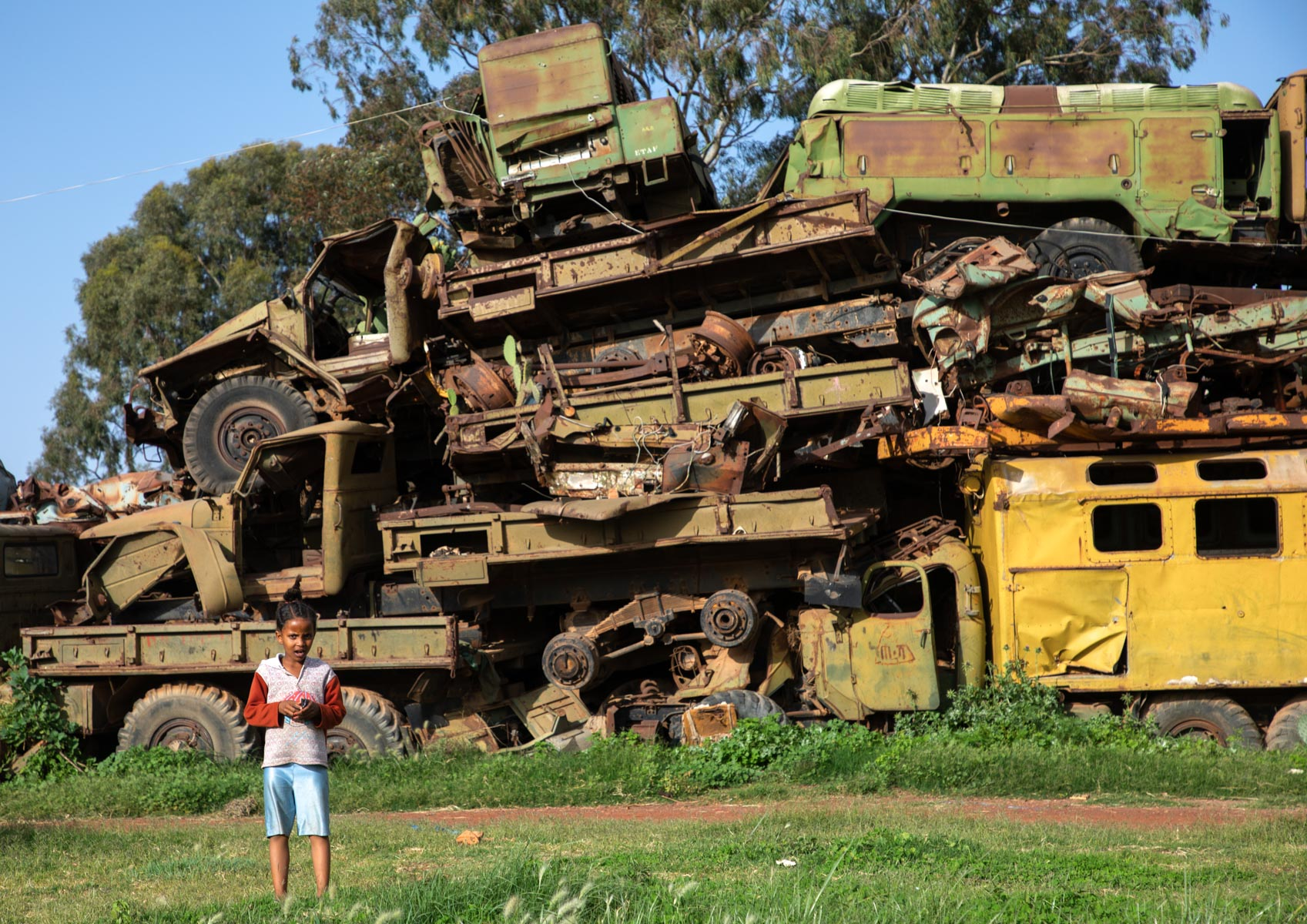 22 August 2019: An Eritrean child plays in the military vehicle graveyard in the capital city of Asmara. (Photograph by Eric Lafforgue/ Art in All of Us/ Corbis via Getty Images)