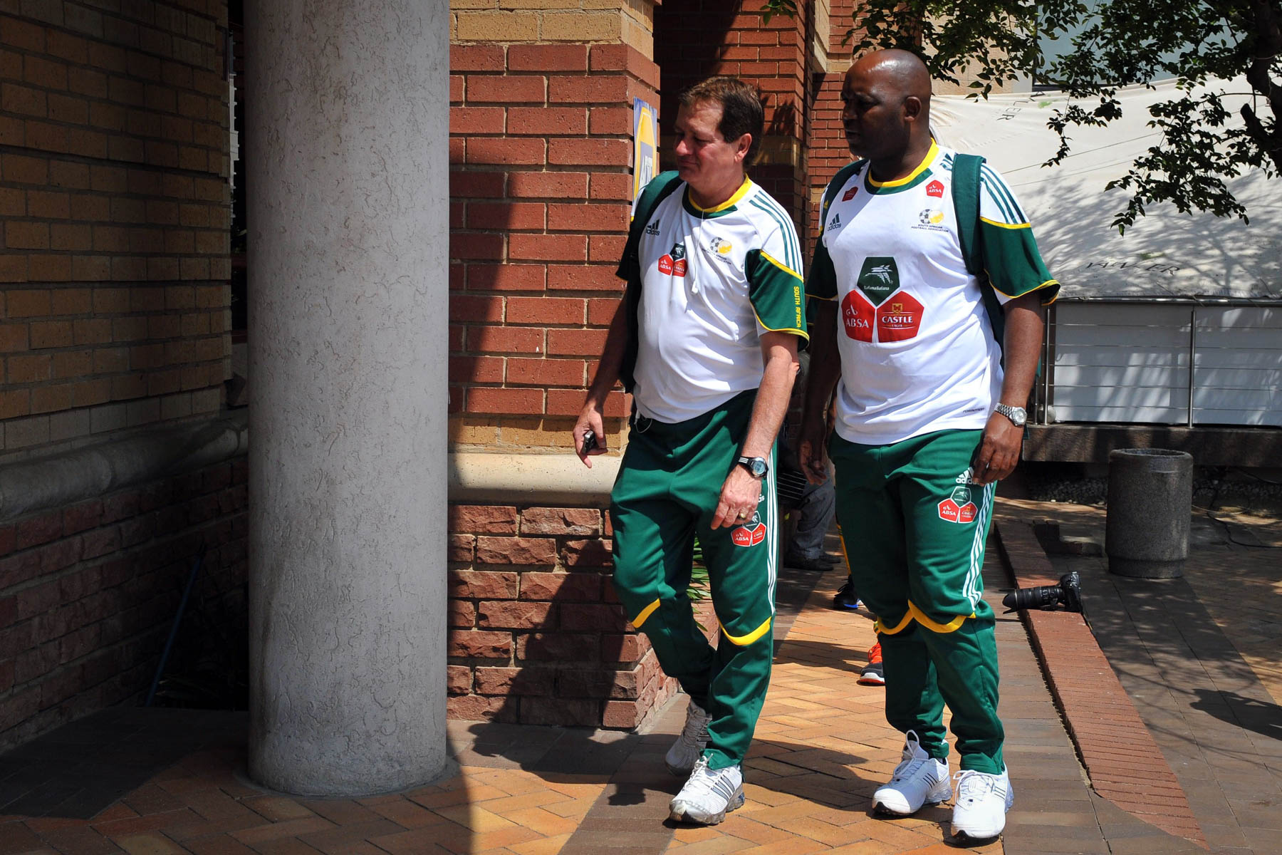 6 October 2010: From left, Bafana assistant coach Jairo Leal and coach Pitso Mosimane arrive for a team gym session in Fourways, Johannesburg. (Photograph by Duif du Toit/ Gallo Images)