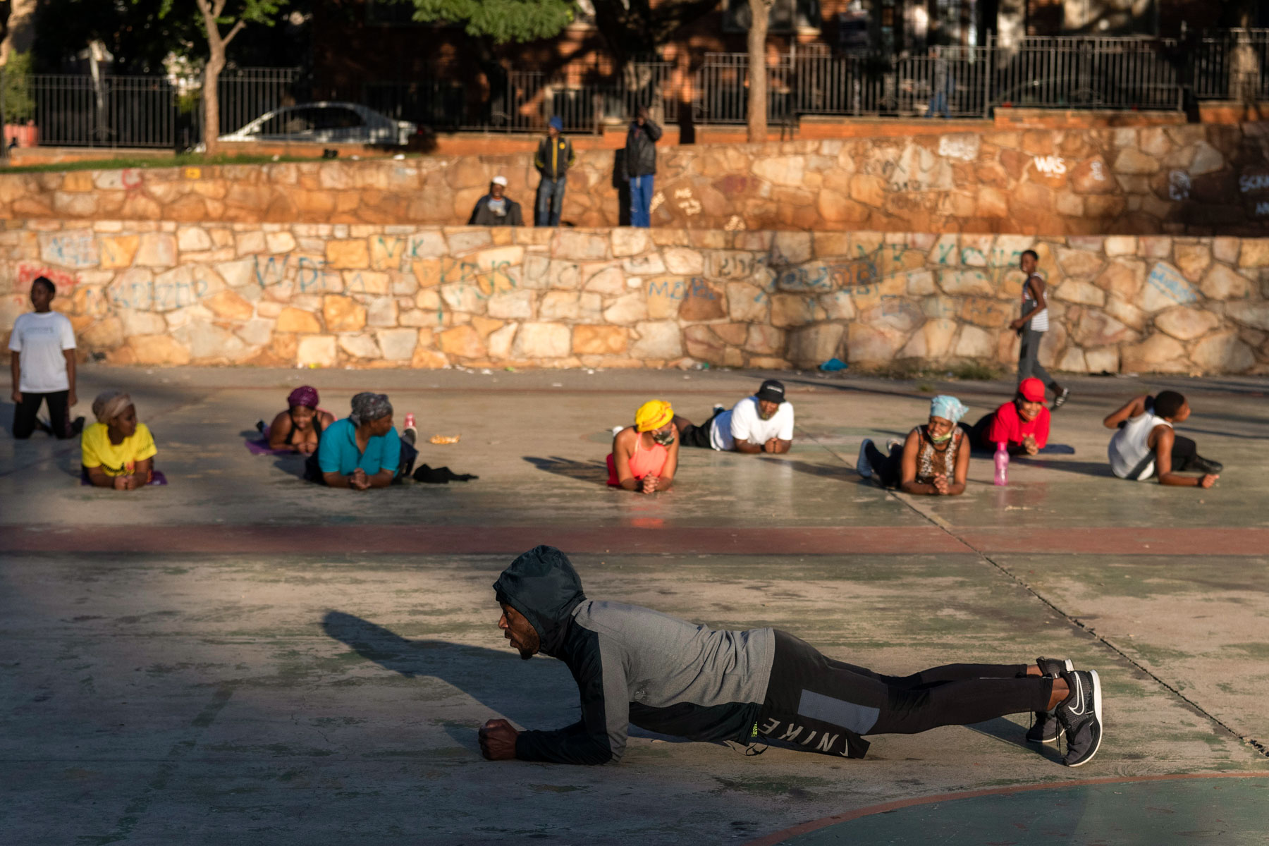 12 May 2020: Thulani Khupe leads people in an early morning exercise routine in Berea, Johannesburg.