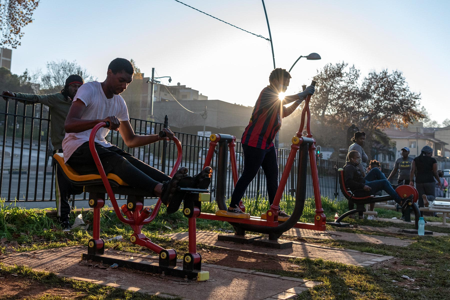 12 May 2020: Residents otherwise stuck inside small flats in the inner city of Johannesburg make use of the outdoor gym facilities during the morning exercise window.