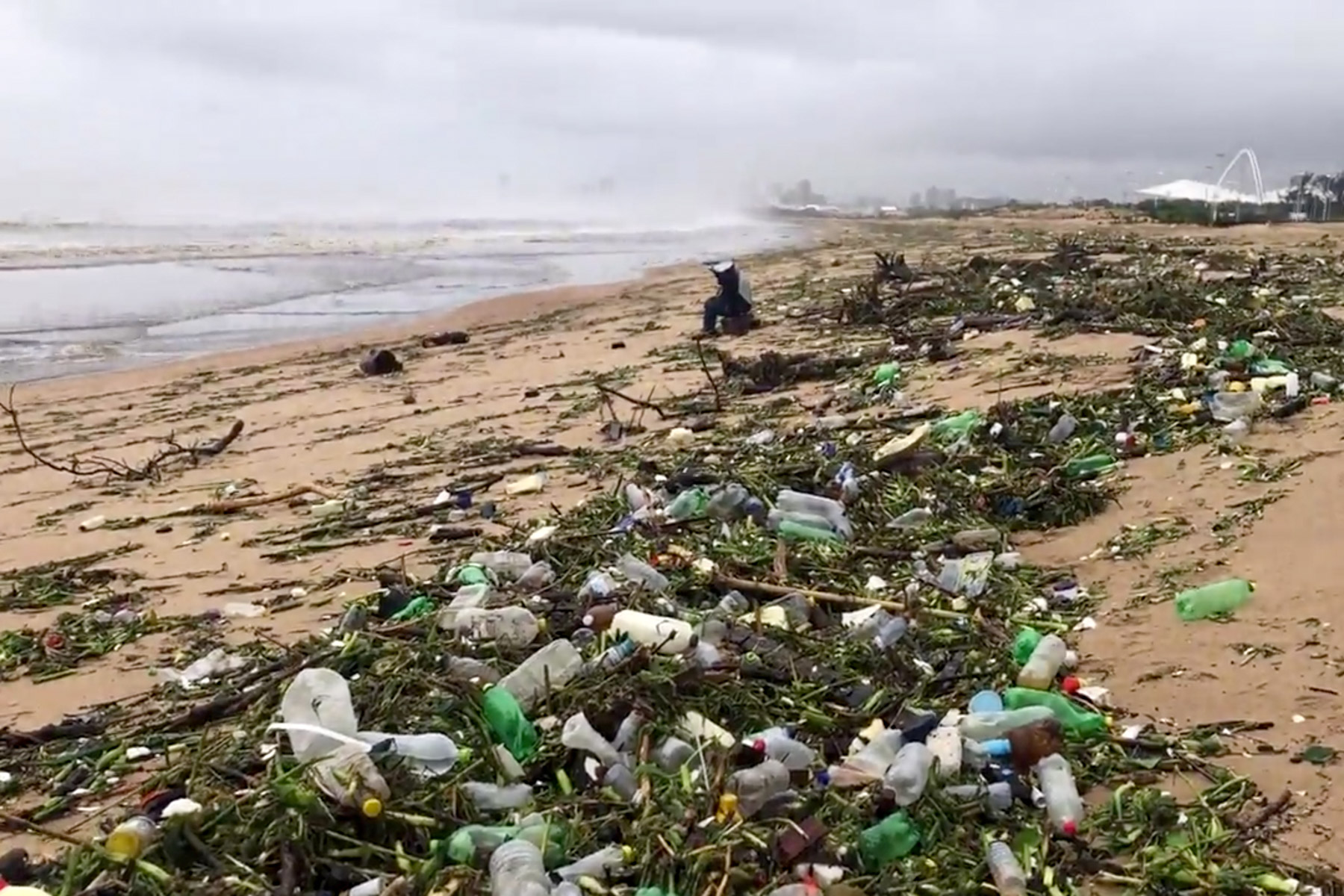 12 December 2019: Mounds of plastic rubbish litter the beach near the mouth of the Umgeni River in Durban, KwaZulu-Natal. (Photograph by Reuters/ Mike Frew)