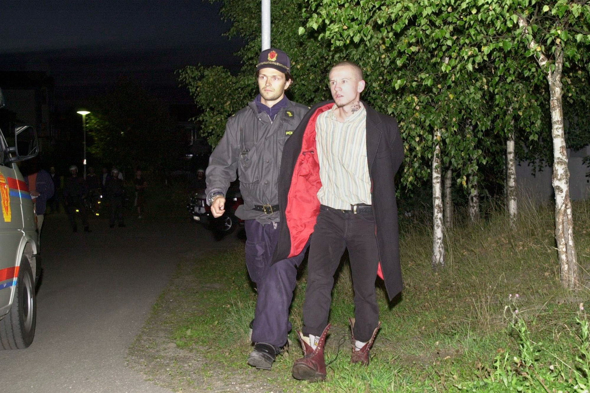 1 May 1996: From left, a police officer detains Petter Gundersen, one of the five neo-Nazis who were charged with the murder of 15-year-old Benjamin Hermansen in January 2001. (Photograph by Alexander Nordahl/ All Over Press Norway/ Liaison)