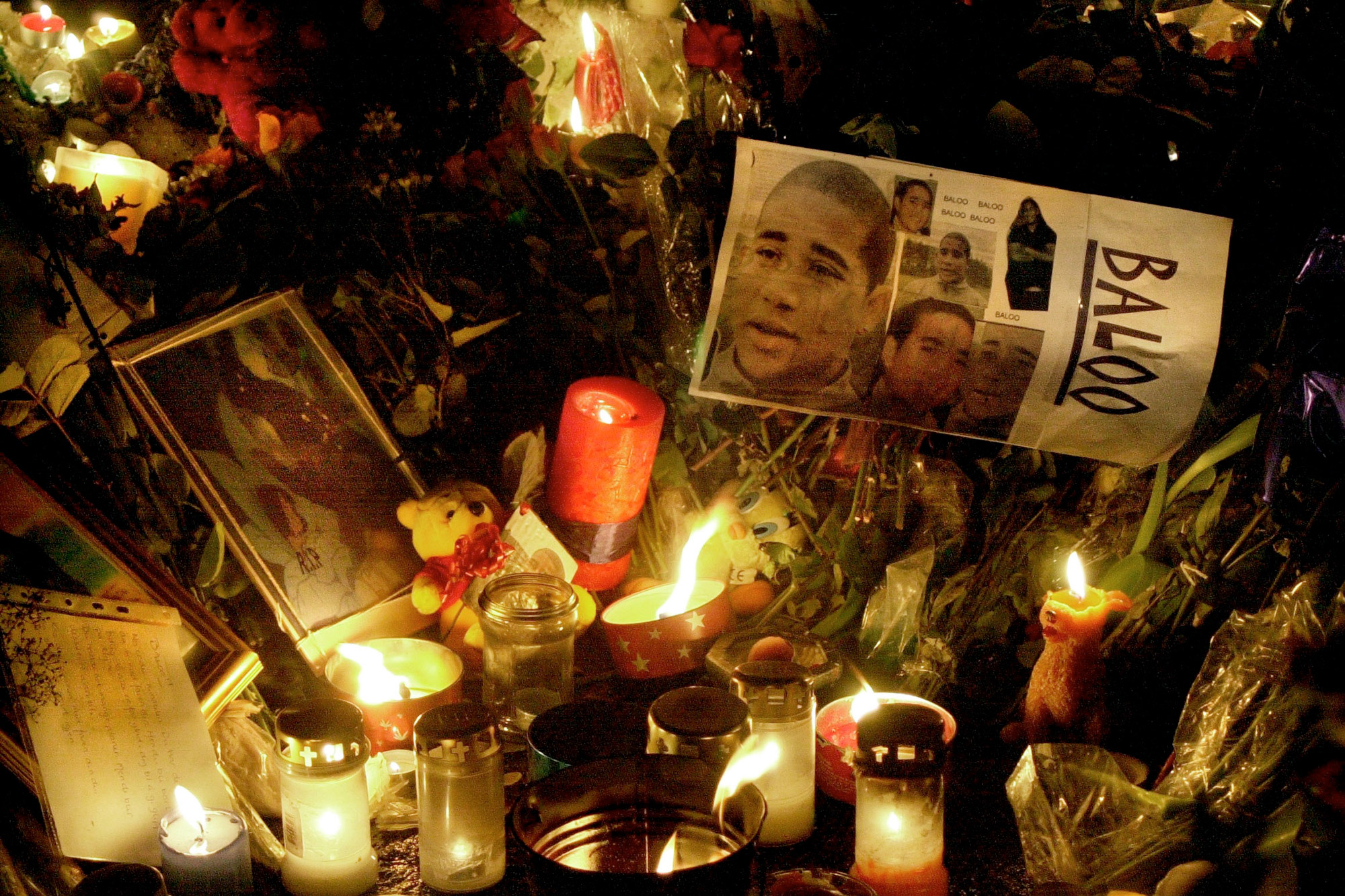 28 January 2001: Photos and candles cover the ground at the spot where Benjamin Hermansen was knifed and killed in a racially motivated attack. (Photograph by Jeanette Landfald/ All Over Press Norway/ Liaison)