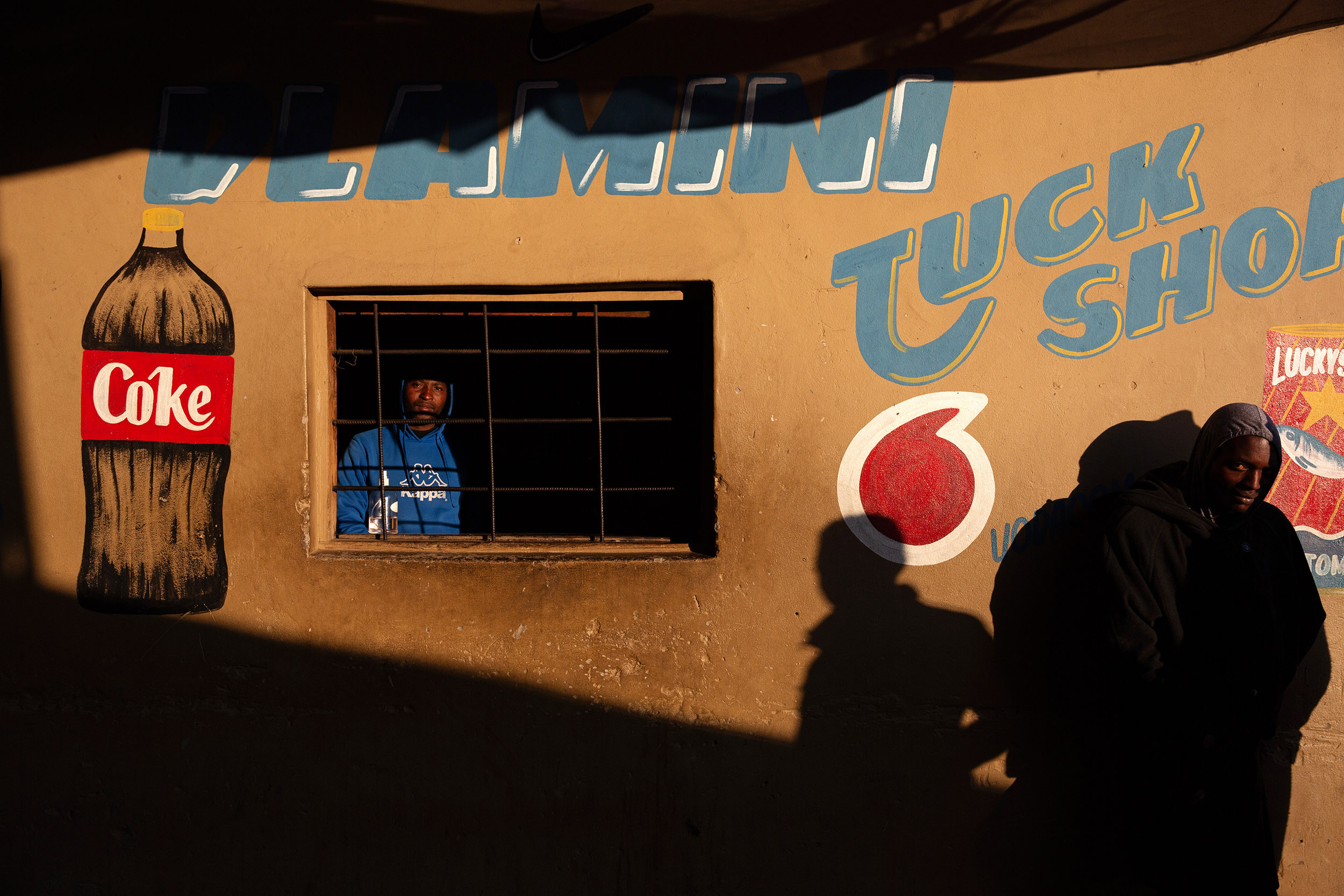 9 July 2020: Sidwell Dlamini from Msinga in KwaZulu-Natal runs a tuckshop in Makause shack settlement. Although foot traffic is sparse, street traders and shop owners are starting to make ends meet.