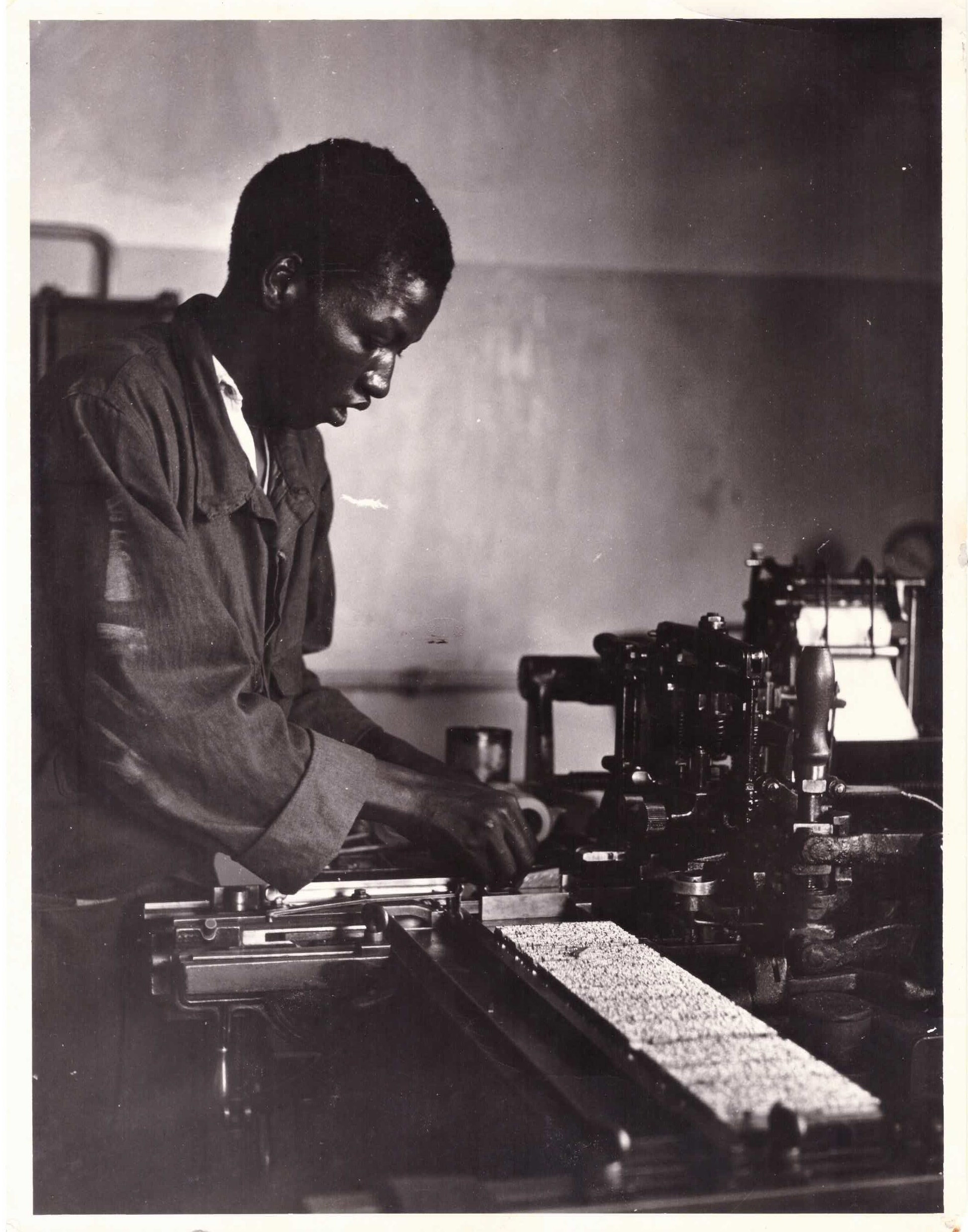 Undated: An unidentified young man setting type at Lovedale Press in readiness for printing. (Image courtesy of Amathole Museum, King William's Town)