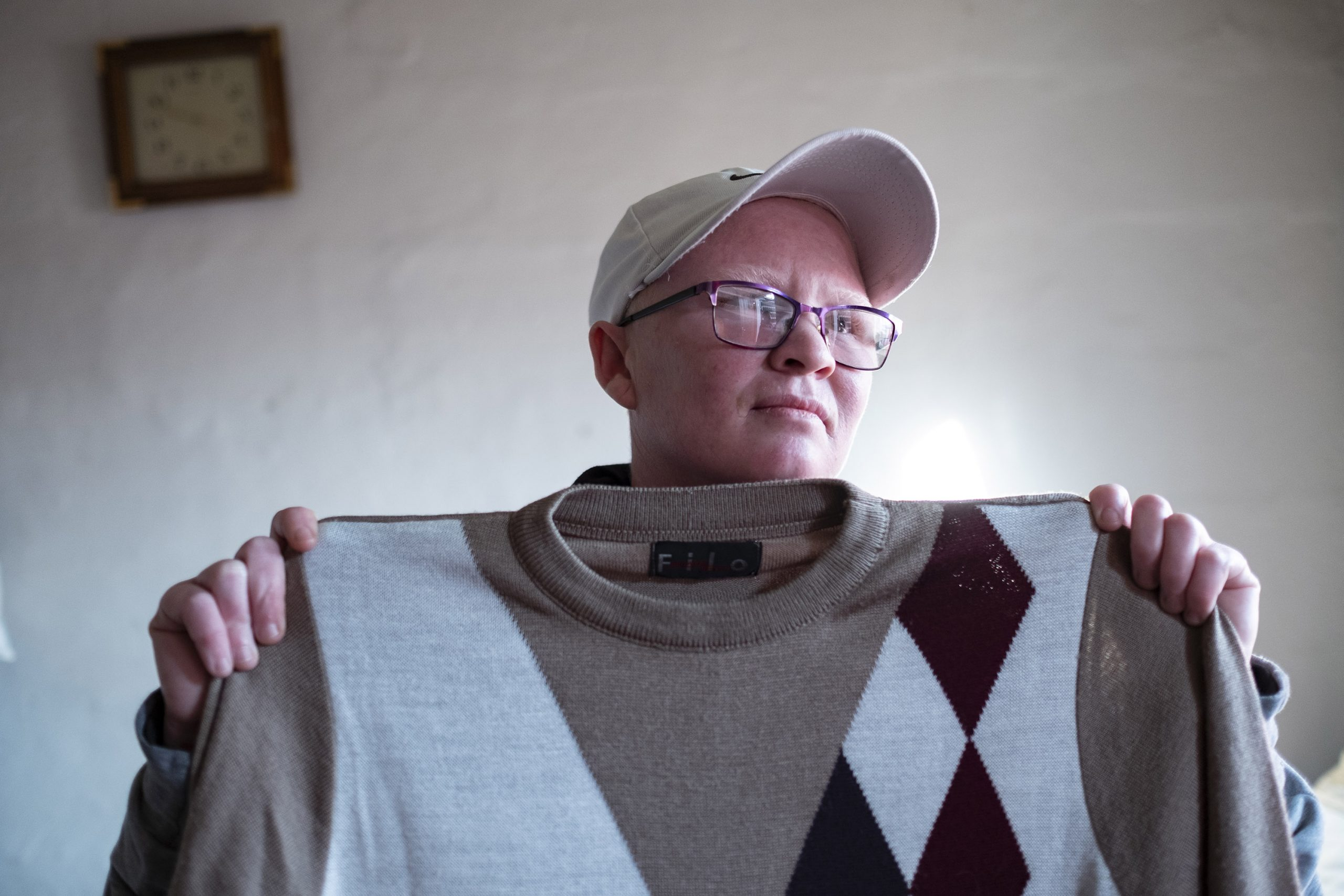 9 June 2020: Valene Meintjies, Cecilia Meintjies' daughter, lives with her wife in a Wendy house in her mother's backyard. She holds a jersey that used to belong to Petrus Miggels. (Photographs by Barry Christianson)