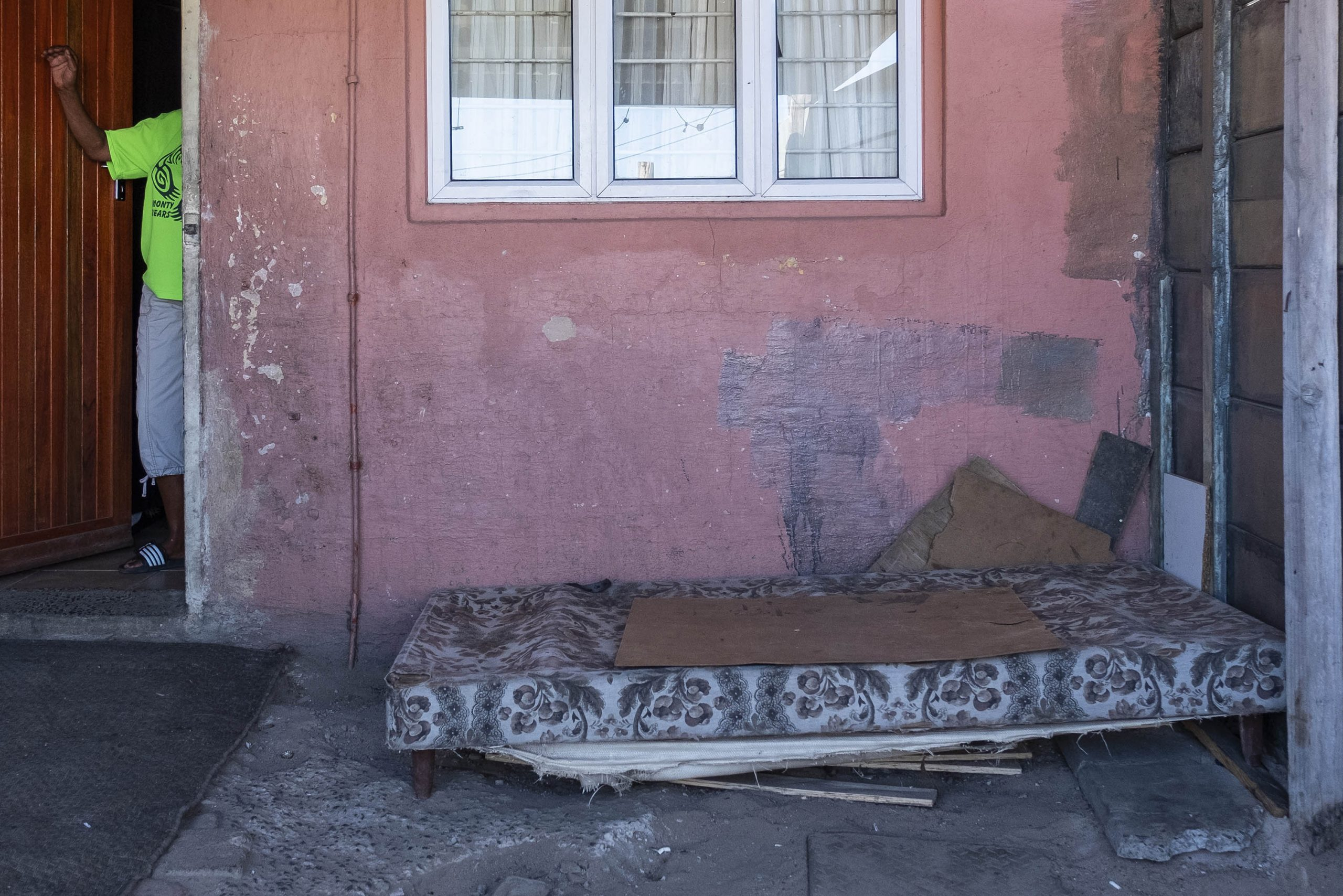 2 April 2020: When Petrus Miggels got home after being assaulted, he told Valene Meintjies what had happened and went to sit on this mattress that lies on the floor just outside their front door.
