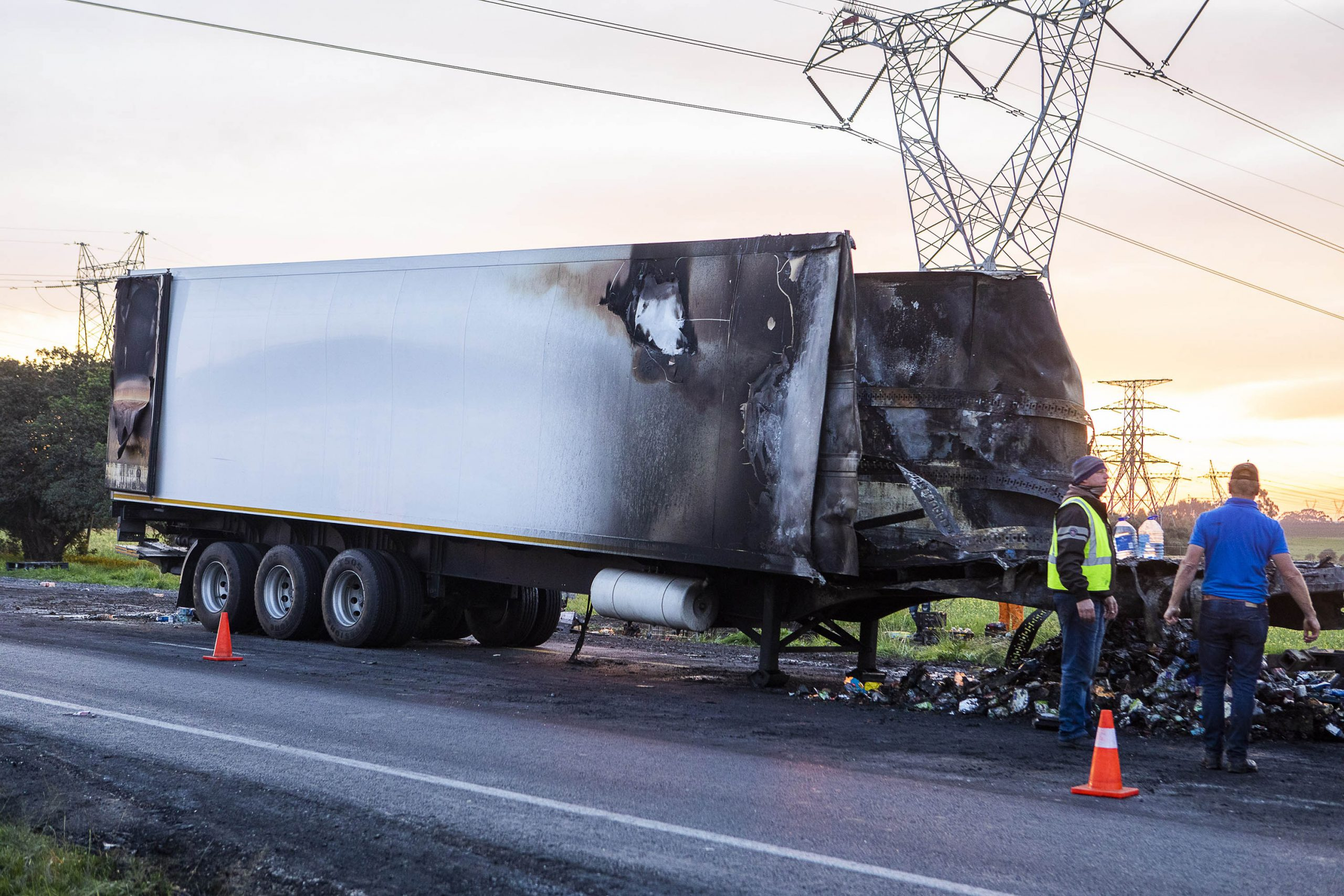 8 July 2020: A burnt-out Pick n Pay truck on the N1 near Klipheuwel in the Western Cape. The N7 and N1 were reportedly both affected by protests after a nationwide call for truck drivers to stop operating in protest against the employment of foreign drivers. They threatened to shut down the entire country. (Photograph by Jacques Stander/ Gallo Images via Getty Images)