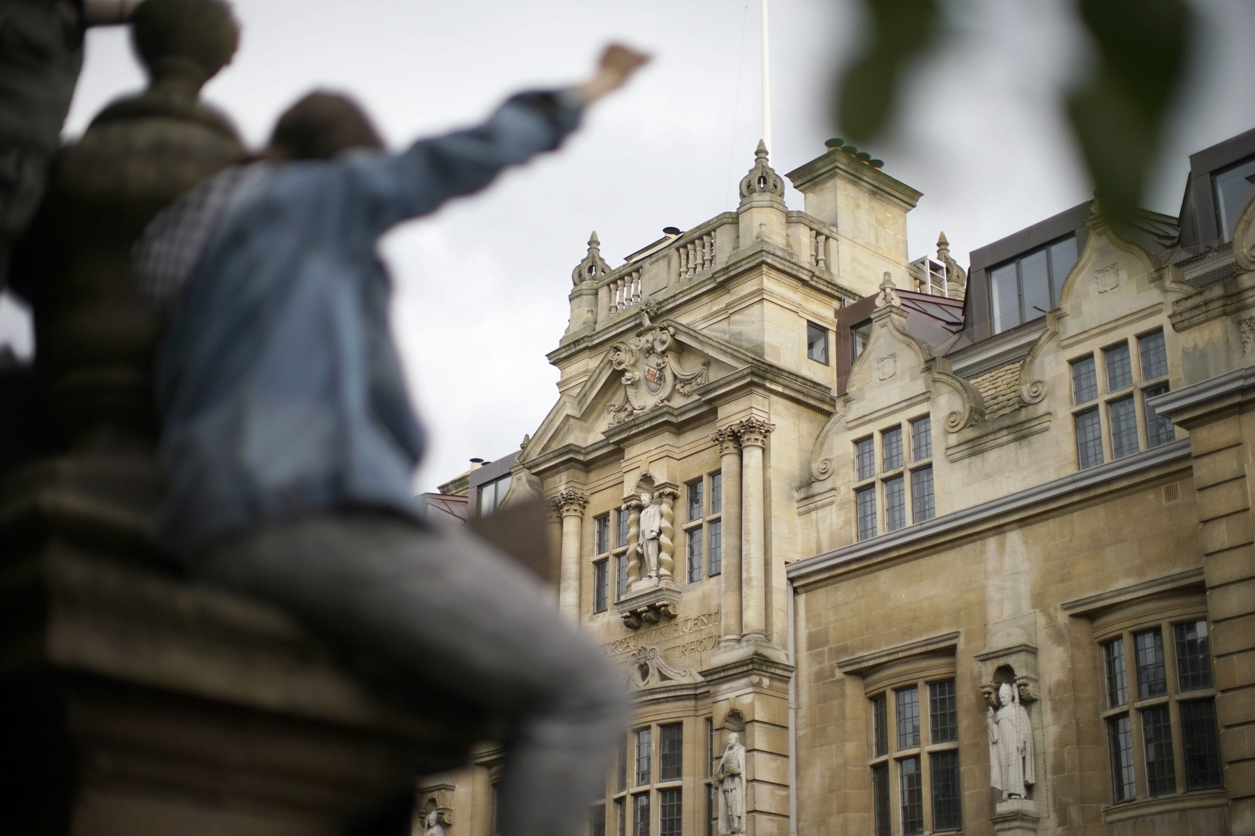 9 June 2020: Demonstrators gather outside University of Oxford's Oriel College during a protest called by the Rhodes Must Fall campaign in Oxford, England. (Photograph by Christopher Furlong/ Getty Images)