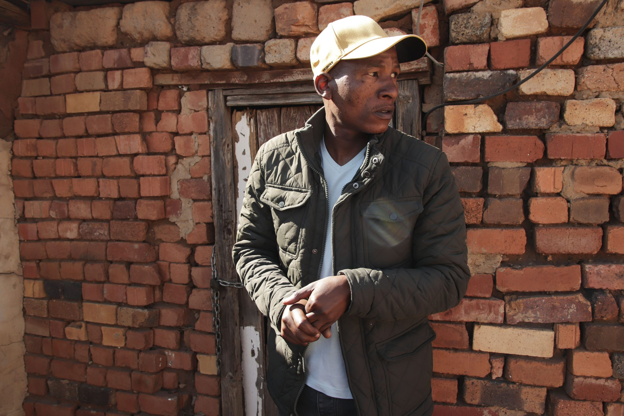 19 July 2020: Andrew Babeile stands in front of the house in the township of Huhudi, Vryburg, where he was born. (Photograph by Gaoretelelwe Molebalwa)
