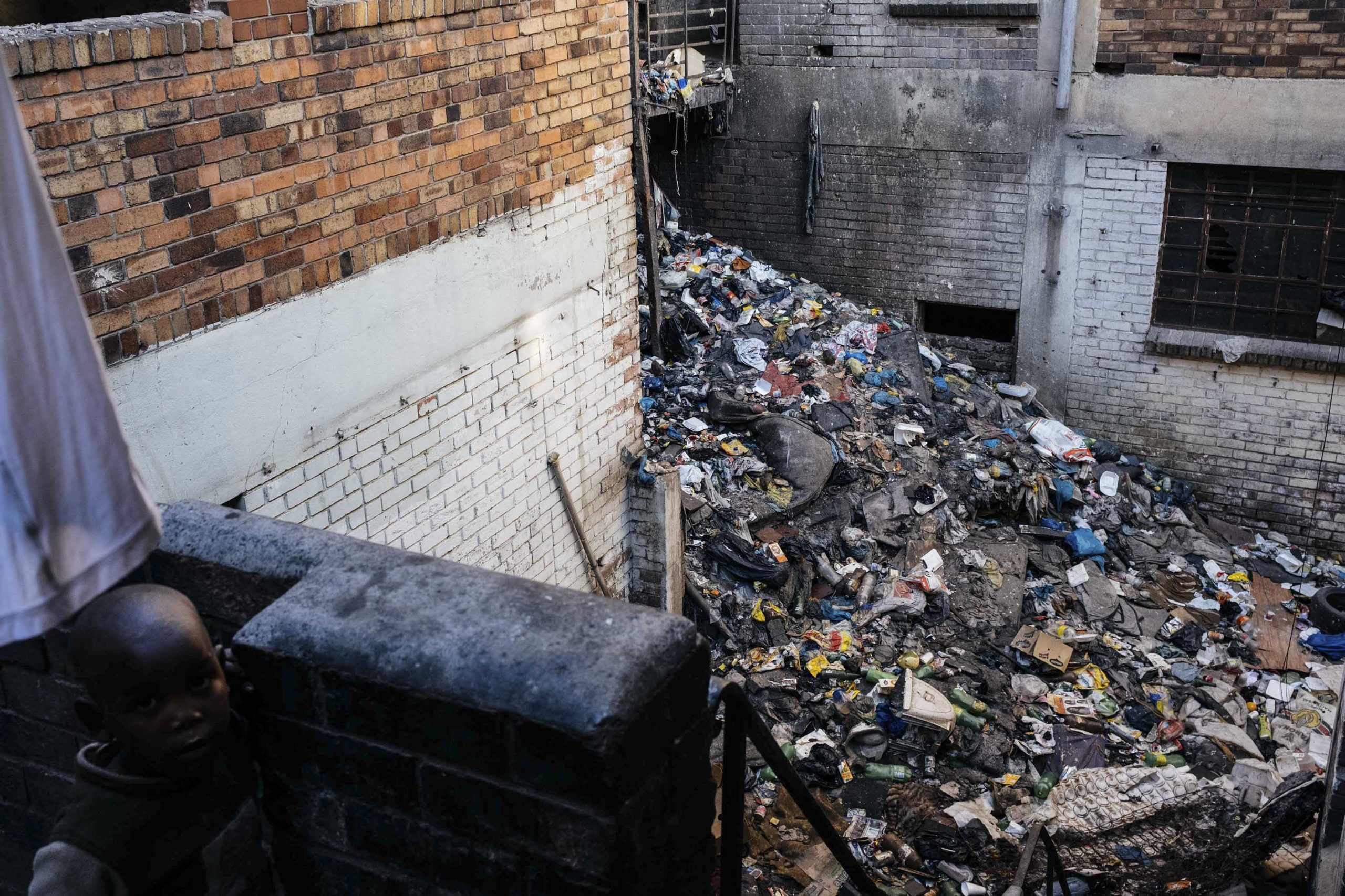 16 July 2020: Rubbish piles up in the courtyard of a derelict building, a health hazard residents have been living with since before the coronavirus pandemic.