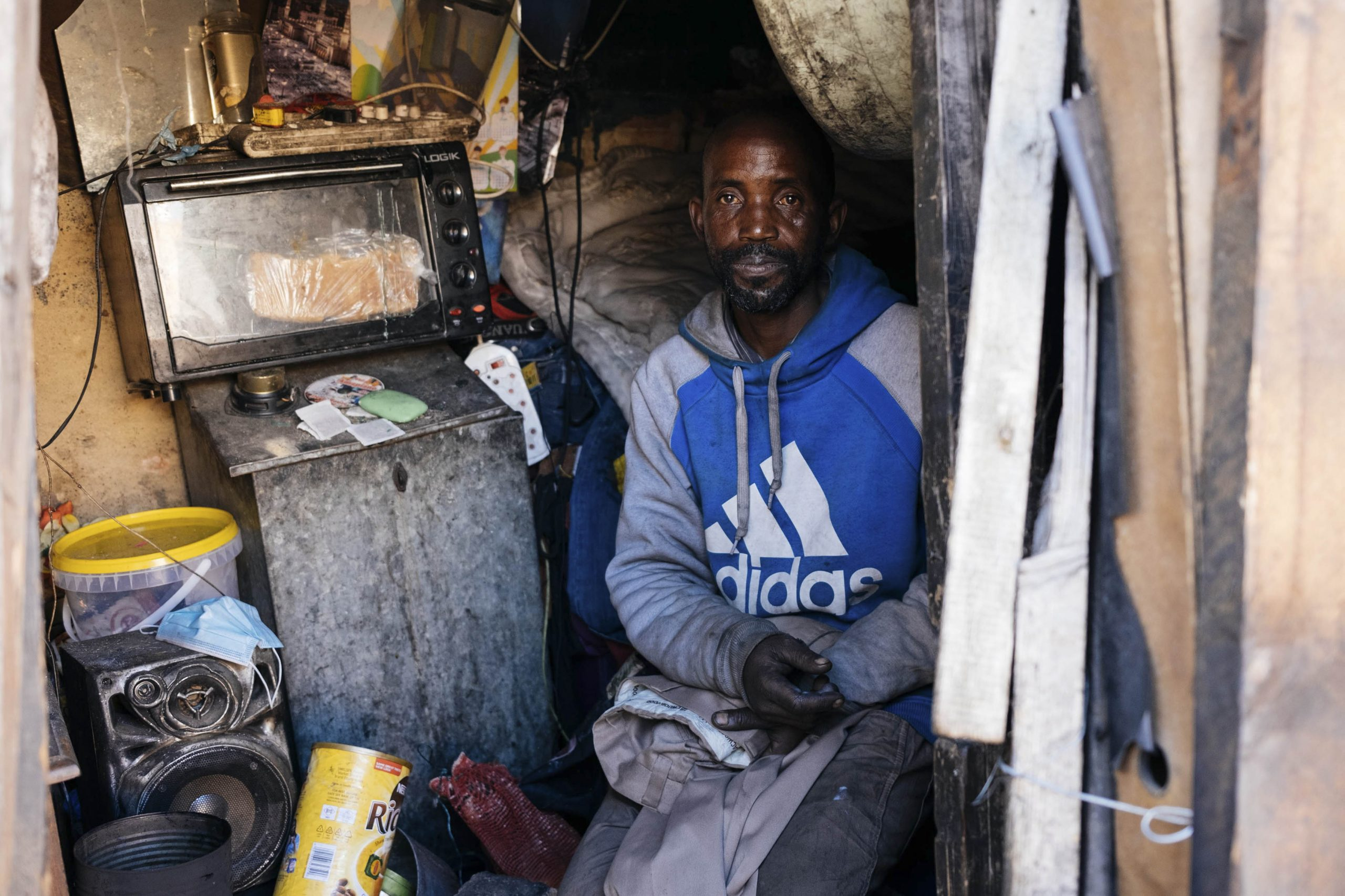 16 July 2020: Thabo Meva, 46, in his small inner-city living space. His most prized possession is a generator, which enables him to run a stove, his speaker and a television. But he does not have running water. He works as a part-time cleaner at the Johannesburg Central Police Station, where he has access to running water for his washing needs.