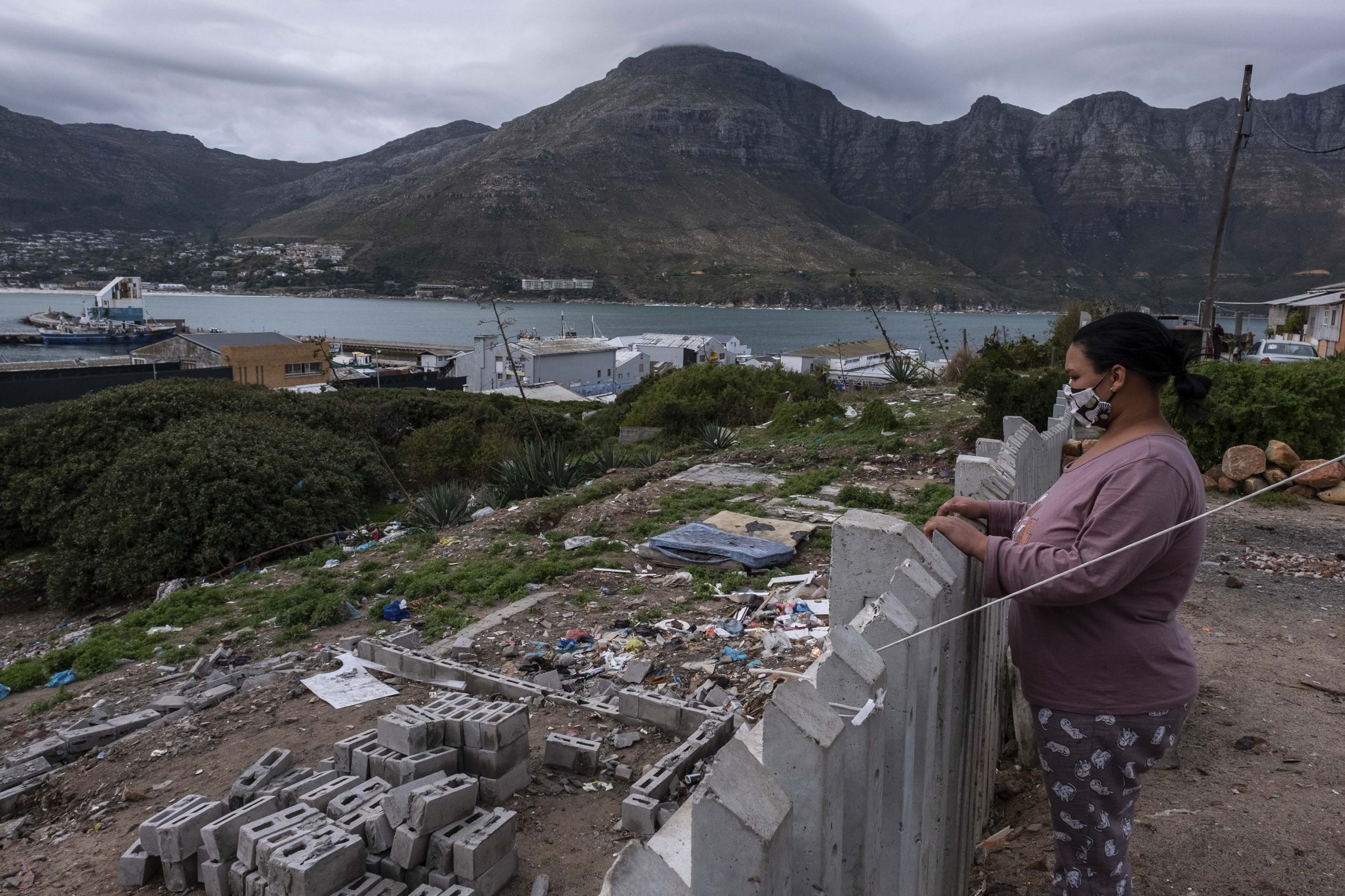 13 June 2020: Mecaylen Galant, a single mother of three, stands above the ruins of her demolished home. Galant used her savings from the stipend she earned volunteering for The Walking Bus project to build her house.