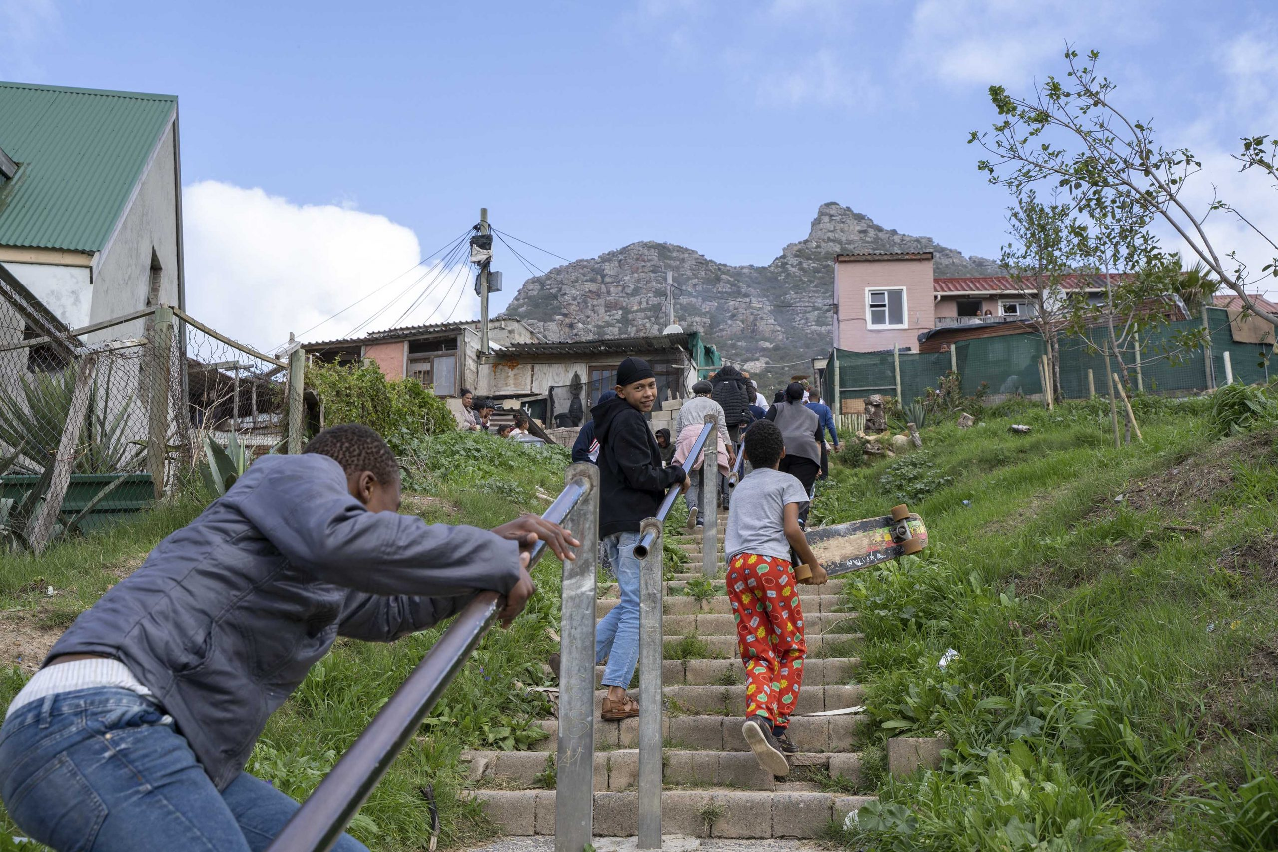 28 June 2020: Children walk up the steep stairs from Karbonkel Road to Salamander Park in Hangberg.