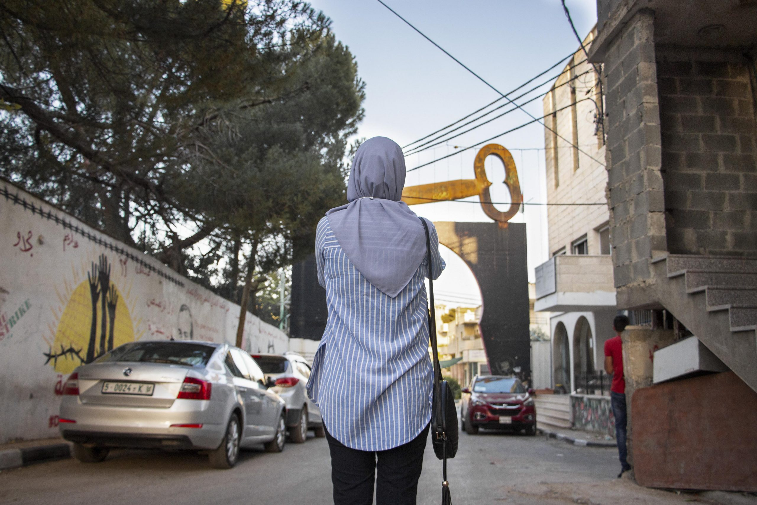 19 July 2020: Iltizam Morrar near the Aida refugee camp. The giant key over the camp's entrance is a symbol of Palestinian rights to the houses and land Israel colonised in 1948. (Photograph by Reem Jarrar)