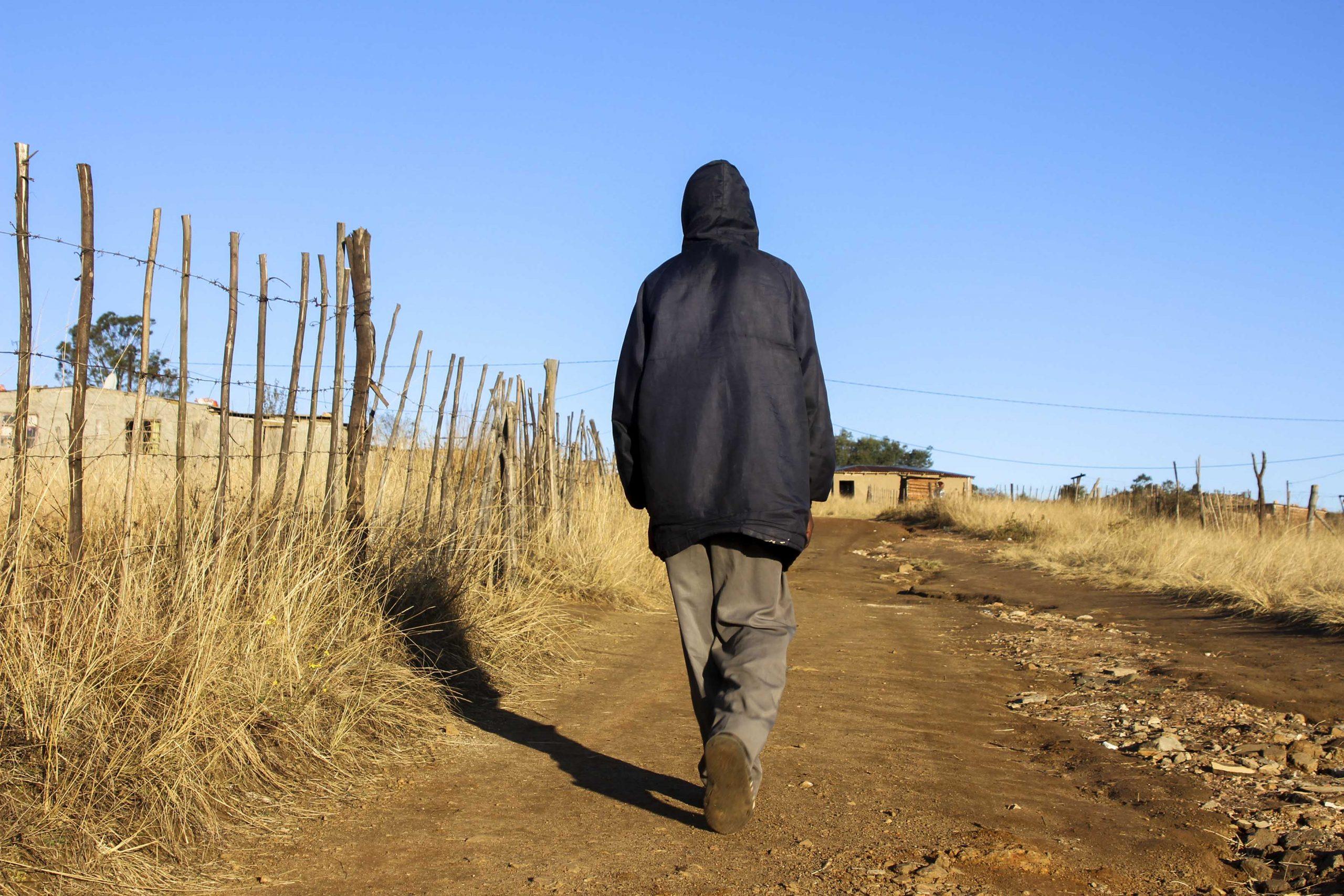 19 June 2020: Jasper Mahlangu (not his real name) on his way home to Thokozani village. He says he was accused of contravening lockdown rules and brutally beaten by police officers.