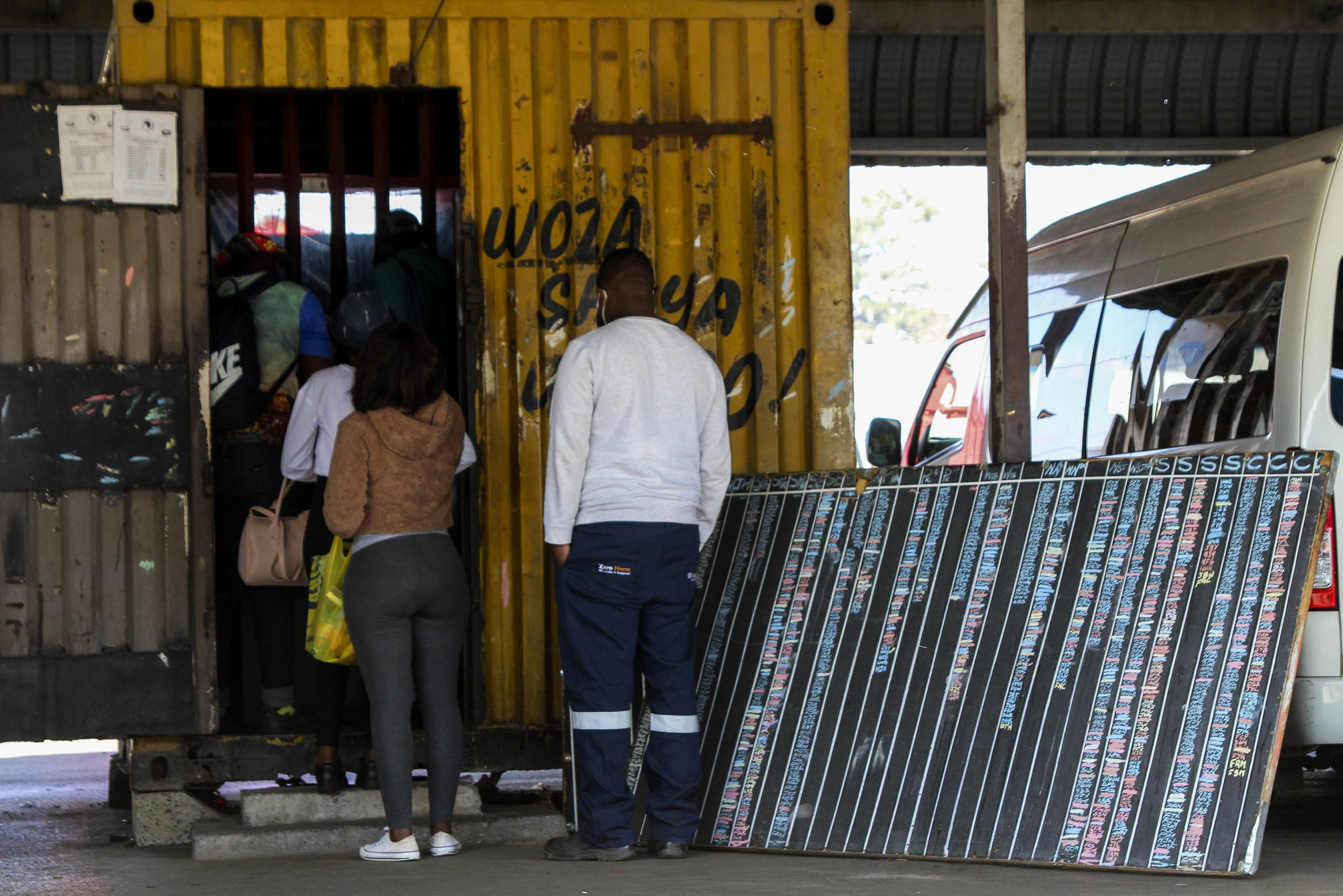 9 June 2020: Passengers queue at the office for long-distance travel in Ermelo, Mpumalanga, to register and pay their fares. (Photograph by Magnificent Mndebele)