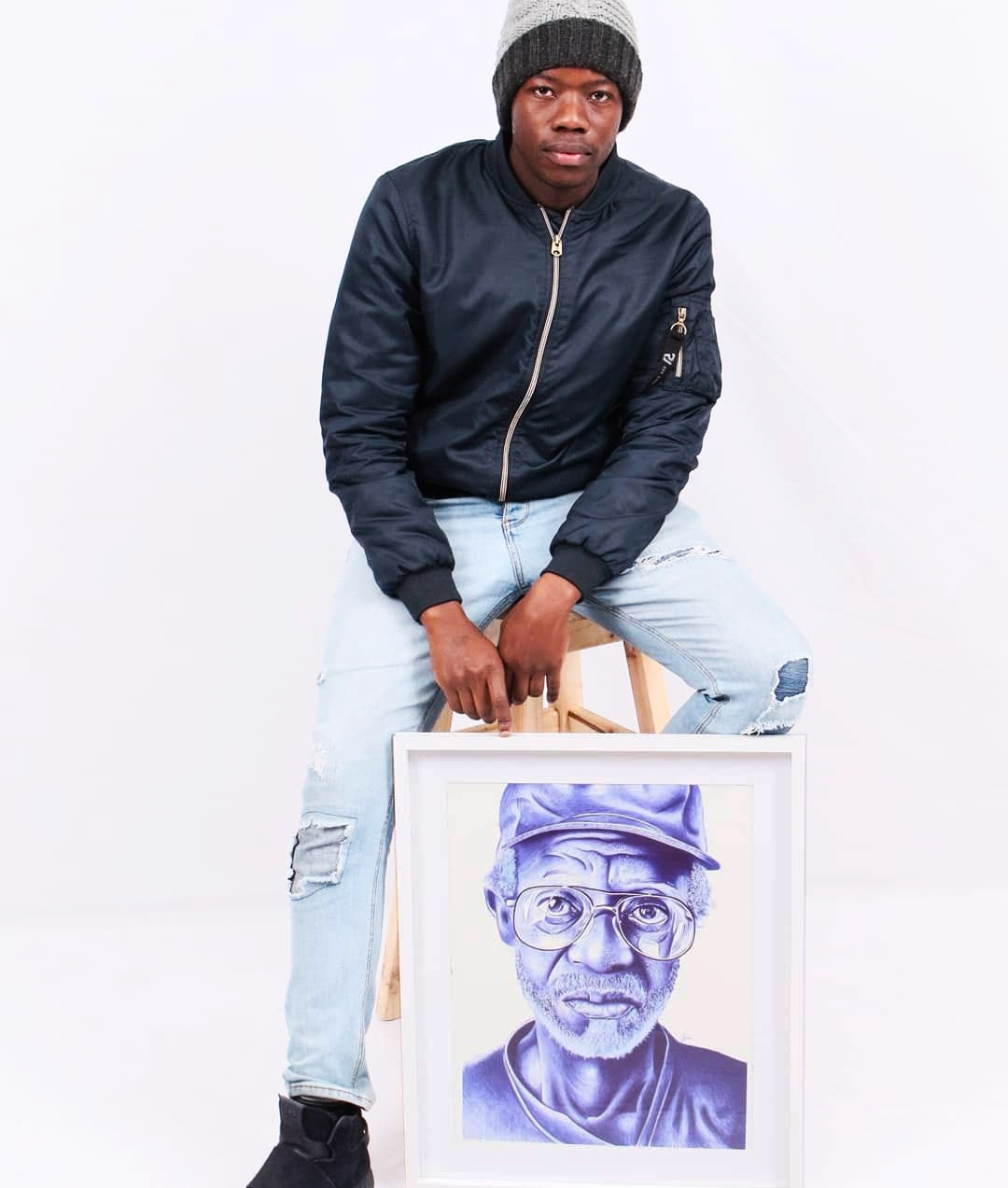 29 June 2020: Artist Zwelakhe Ngobese with the completed portrait from his 'Madala' series. (Photograph supplied)