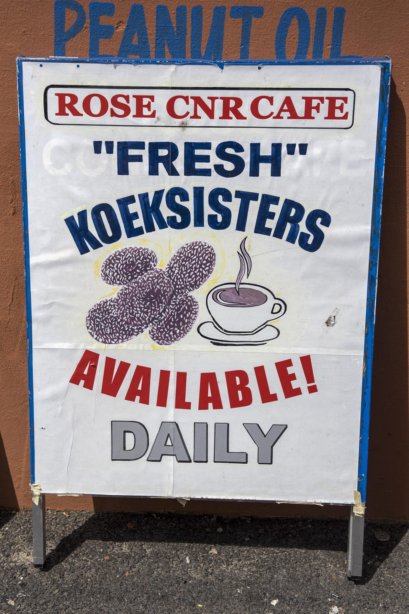 Undated: The sign advertising fresh koe'sisters outside Rose Corner Cafe in the Bo-Kaap, Cape Town. (Photograph by Ishay Govender)