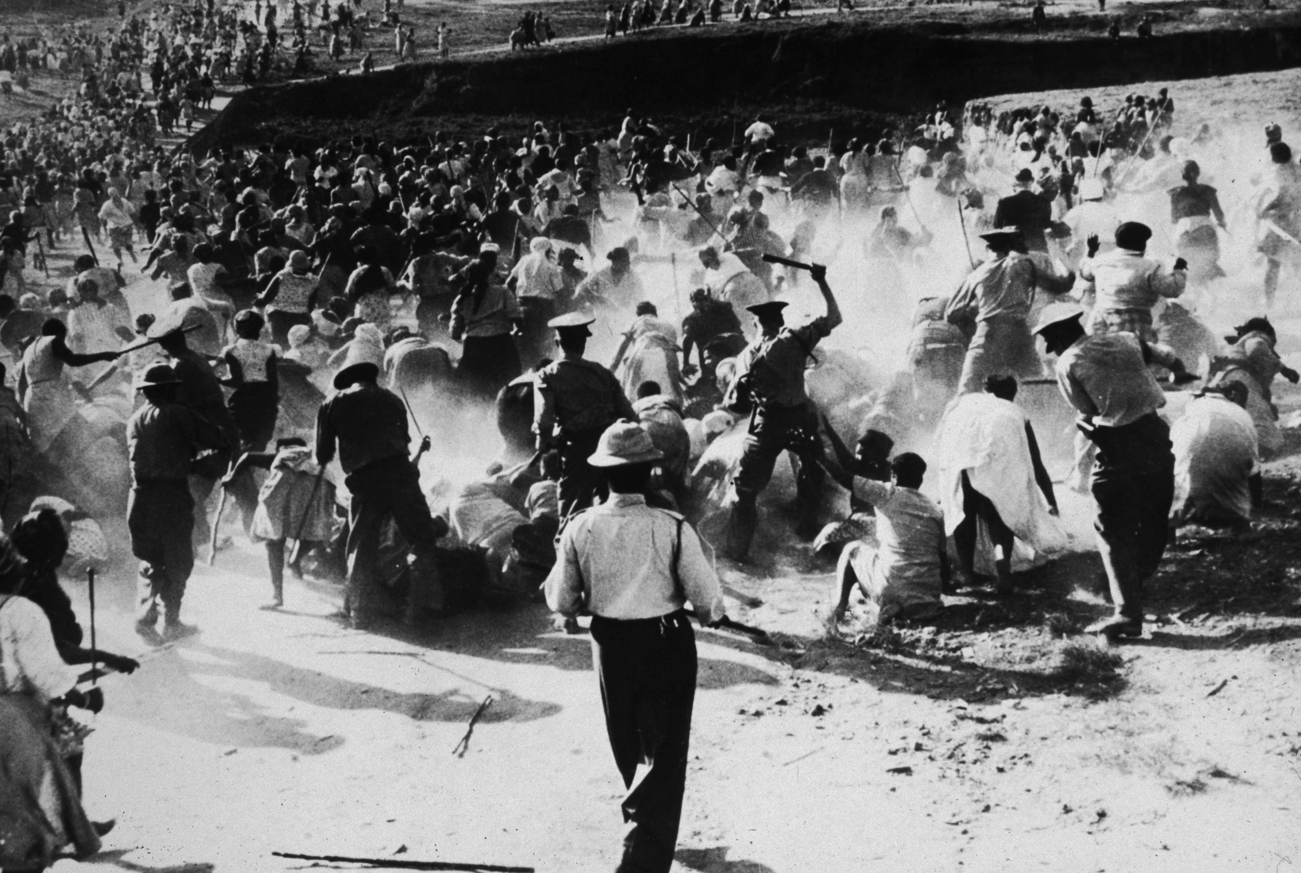1959: South African police officers beat black women with clubs during a protest against apartheid in Durban. (Photograph by Hulton Archive/ Getty Images)
