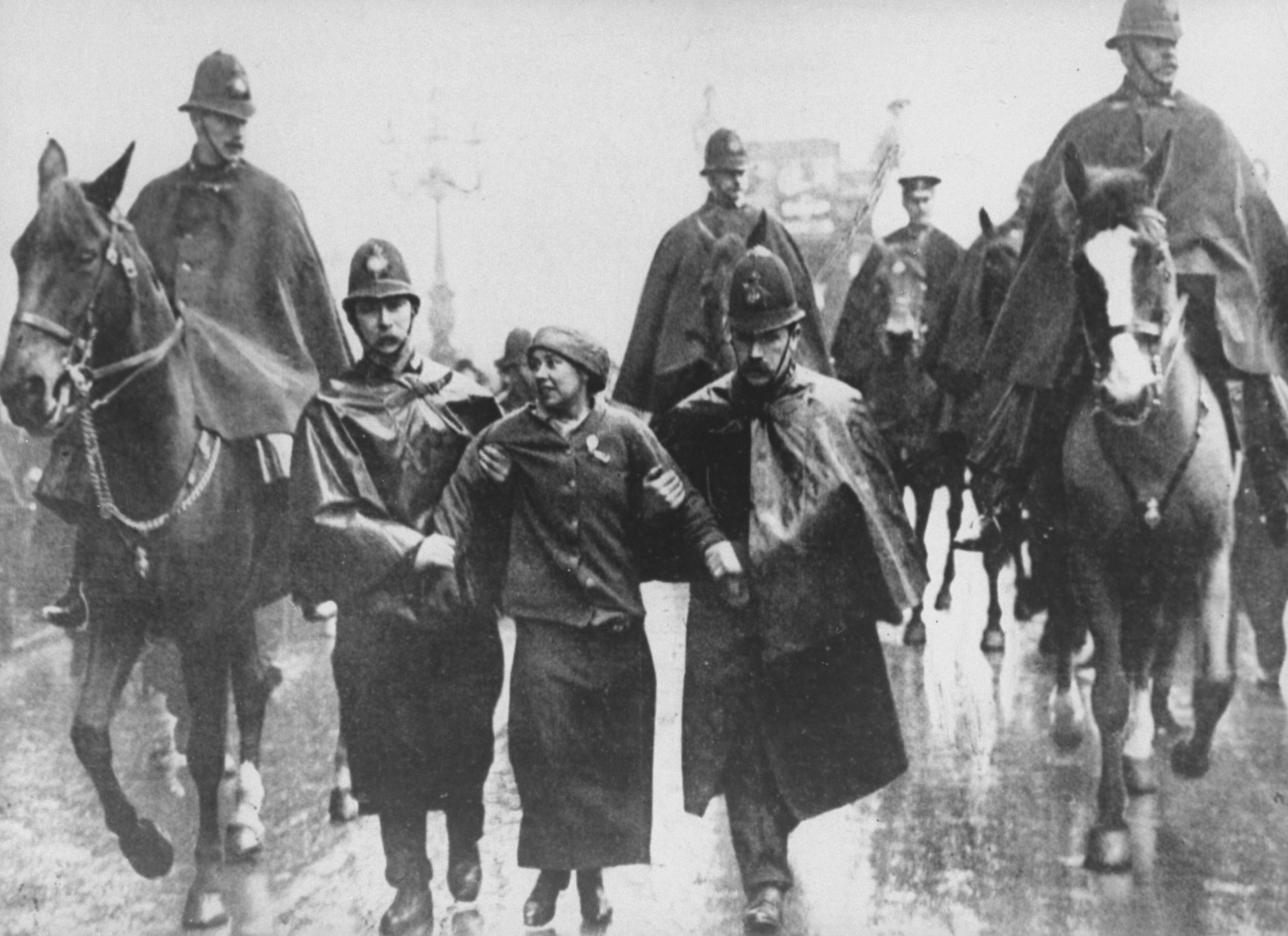 1912: Leading suffragette Sylvia Pankhurst is taken into custody by British police officers during a women's suffrage protest in Trafalgar Square, London, England. In 1829, Robert Peel founded the London Metropolitan Police, the 'bobbies' often regarded as the first modern professional police force. (Photograph by Time Life Pictures/ Mansell/ The LIFE Picture Collection via Getty Images)