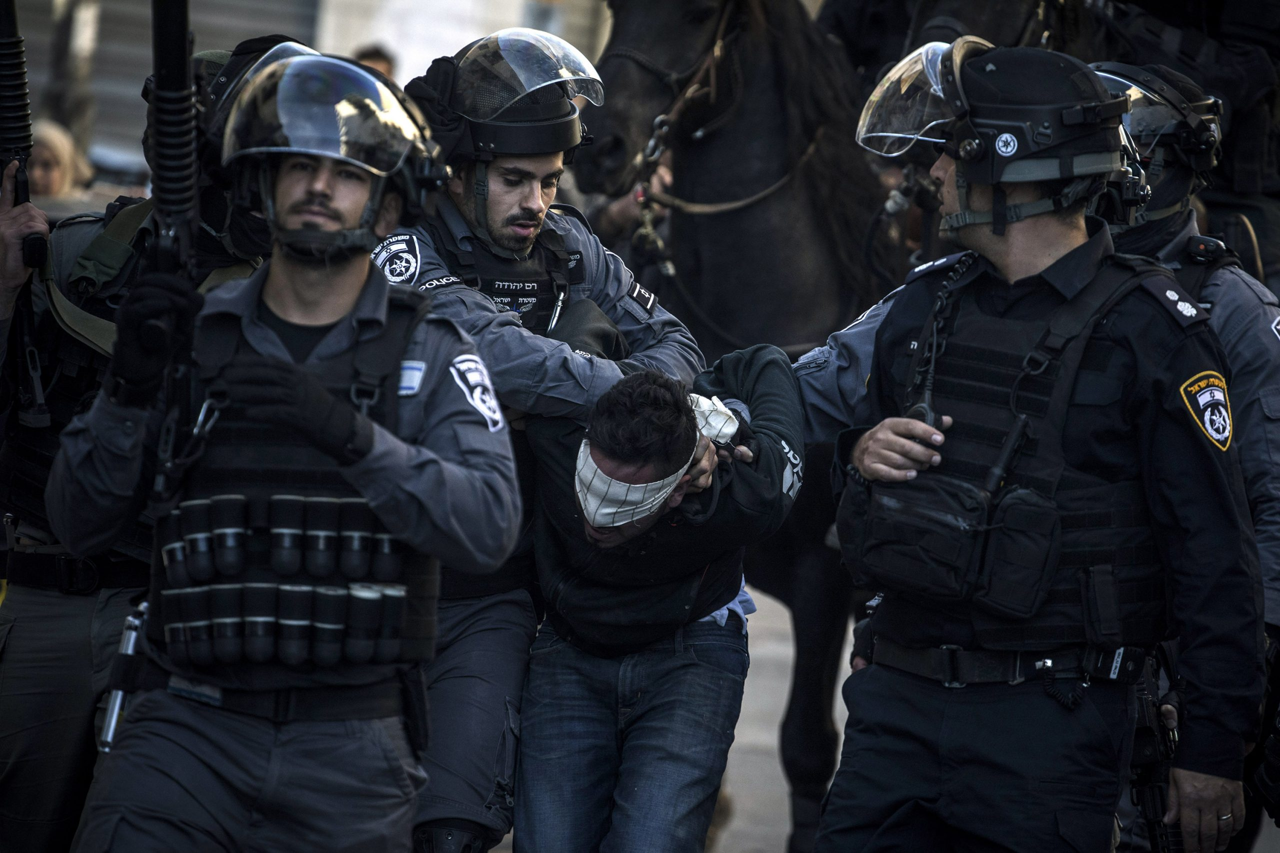 9 December 2017: Police officers arrest a Palestinian protester in Jerusalem. The Israeli police have long been used to crush Palestinian resistance and enforce the occupation of Palestine. (Photograph by Ilia Yefimovich/ Getty Images)