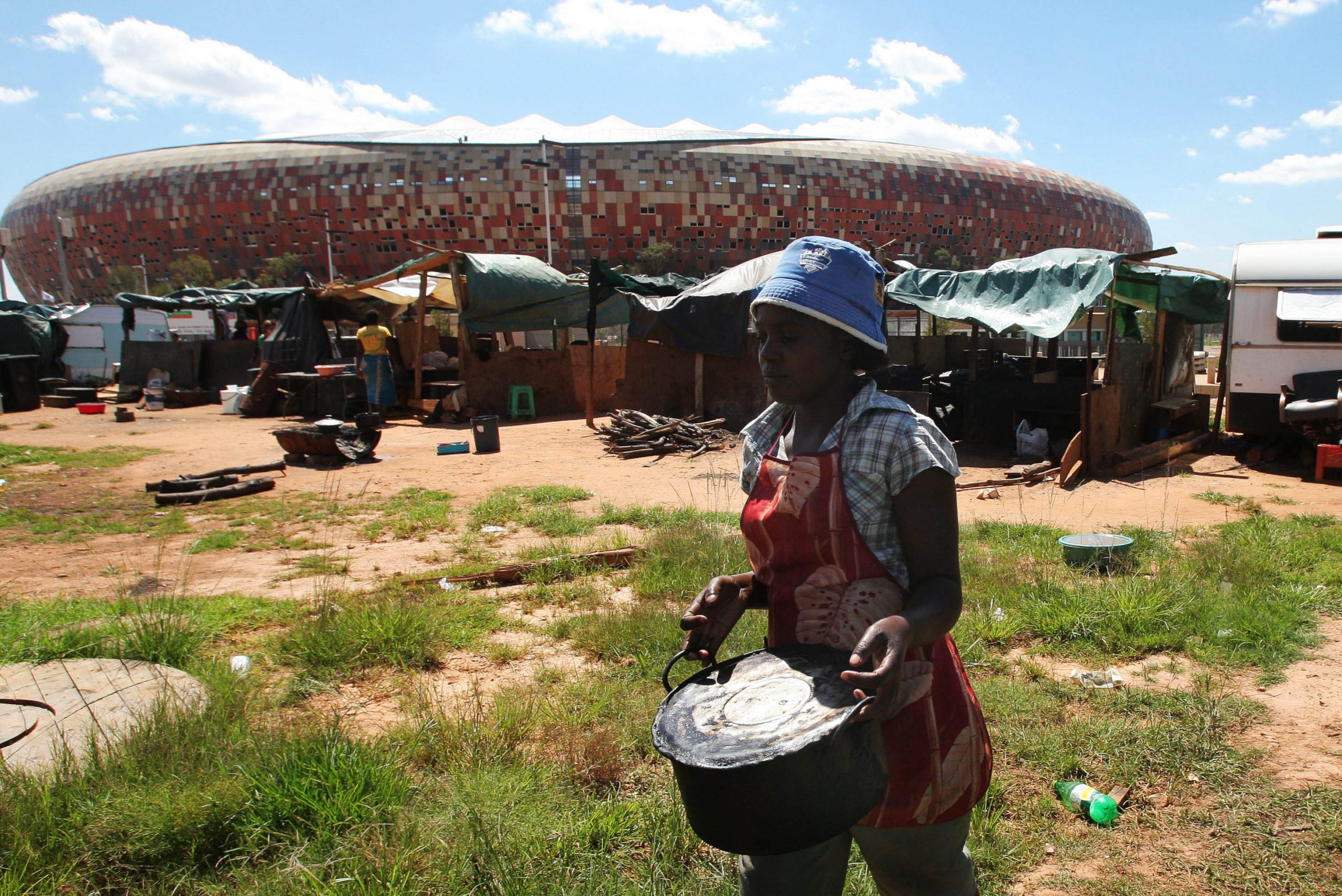 8 March 2010: Food traders outside the Soccer City stadium in Soweto a few months before the start of the 2010 World Cup. They were forced to leave the area in the months leading up to the tournament because of Fifa regulations. (Photograph by Foto24/ Gallo Images/ Getty Images)
