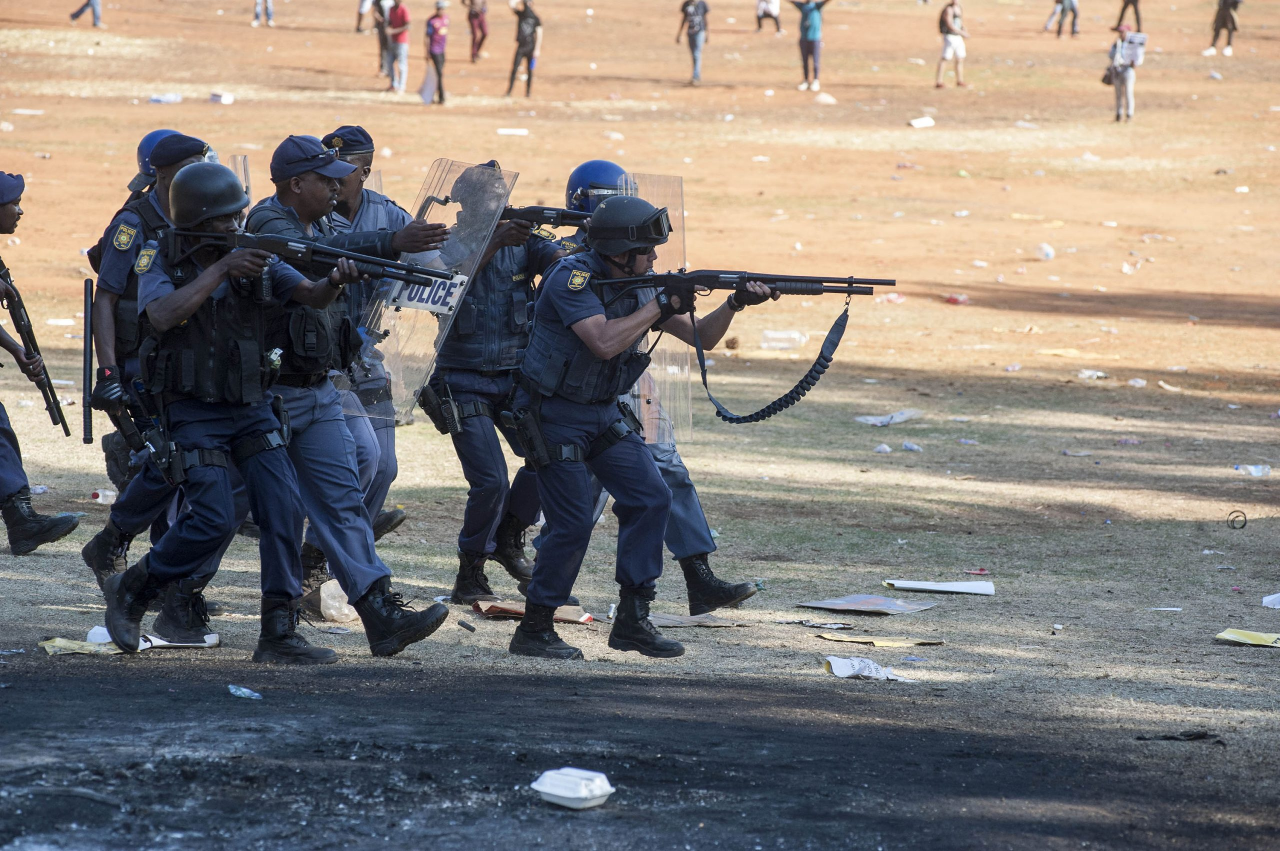23 October 2015: South African police officers move in a military formation as they open fire on students who were protesting against fee increases at the Union Buildings in Pretoria. (Photograph by Ihsaan Haffejee)