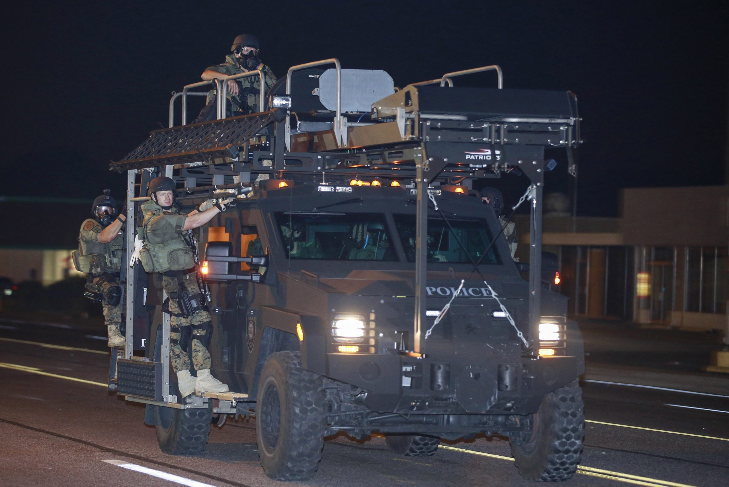 18 August 2014: Officers on a militarised police vehicle in Ferguson, Missouri, as protests continued over the death of 18-year-old Michael Brown. (Photograph by Bilgin Sasmaz/ Anadolu Agency/ Getty Images)