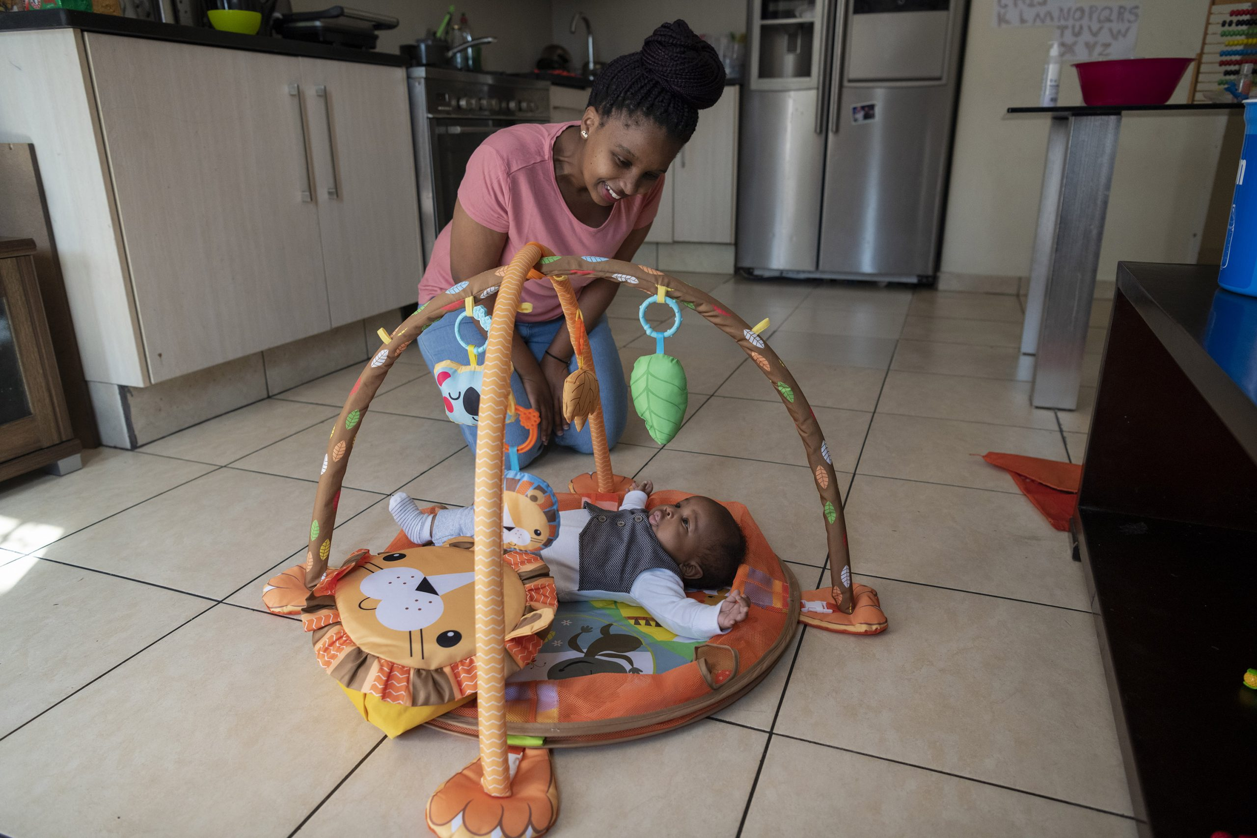 13 August 2020: Thembeka Sibiya plays with her newborn son Khaya.