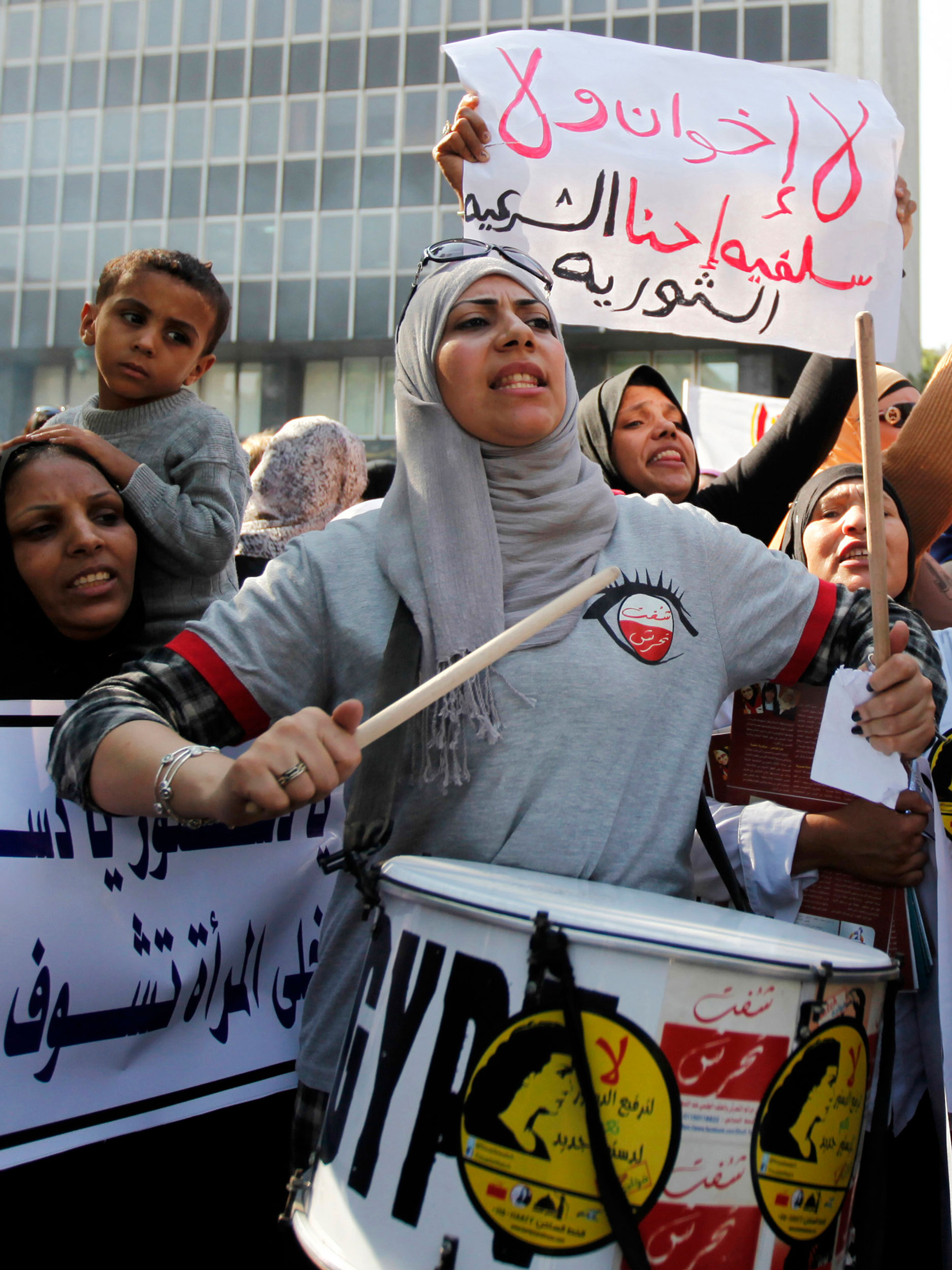 13 November 2013: Protesters demand more rights for women in front of the Shura Council, or upper house of parliament, in Cairo. (Photograph by Reuters/ Mohamed Abd El-Ghany)