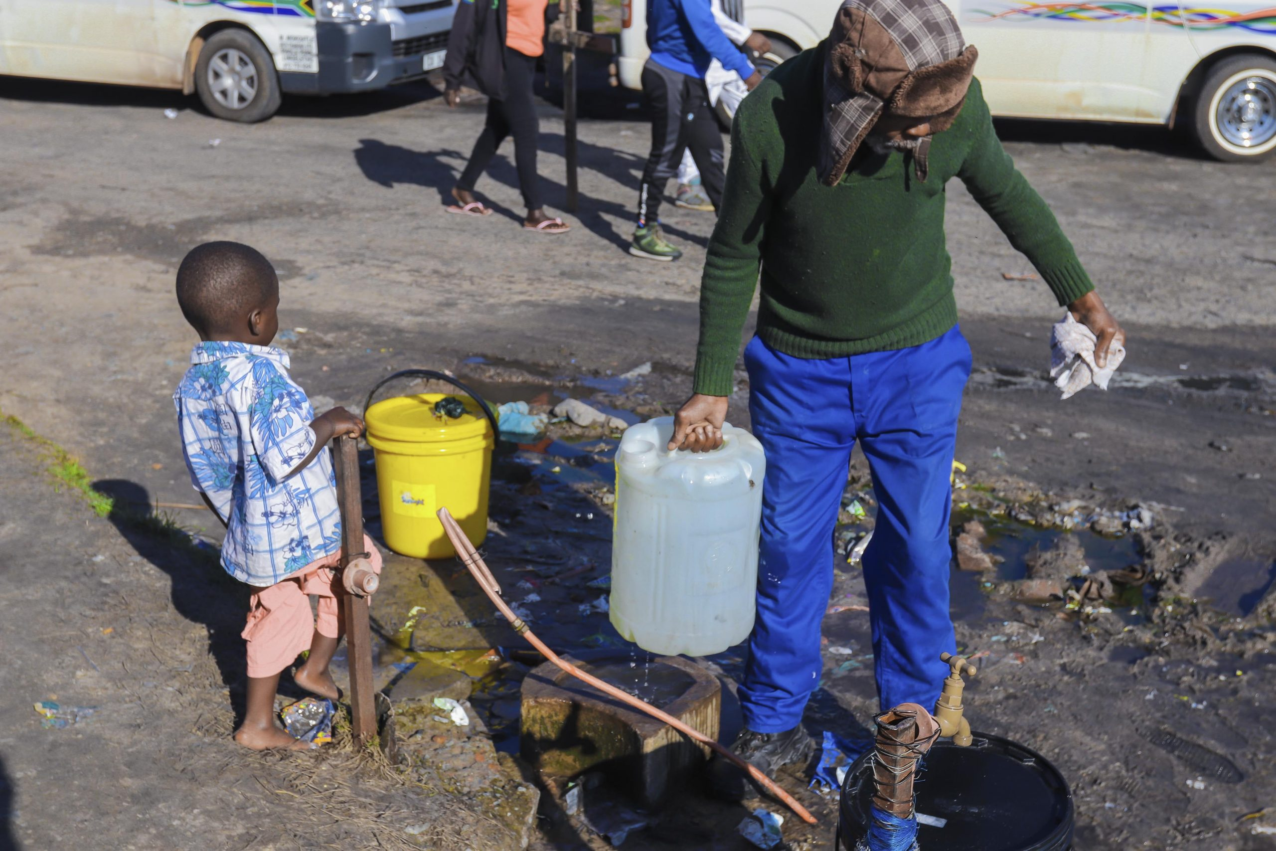 23 July 2020: Sam Khutwana draws water from the two communal taps on which the entire settlement depends.