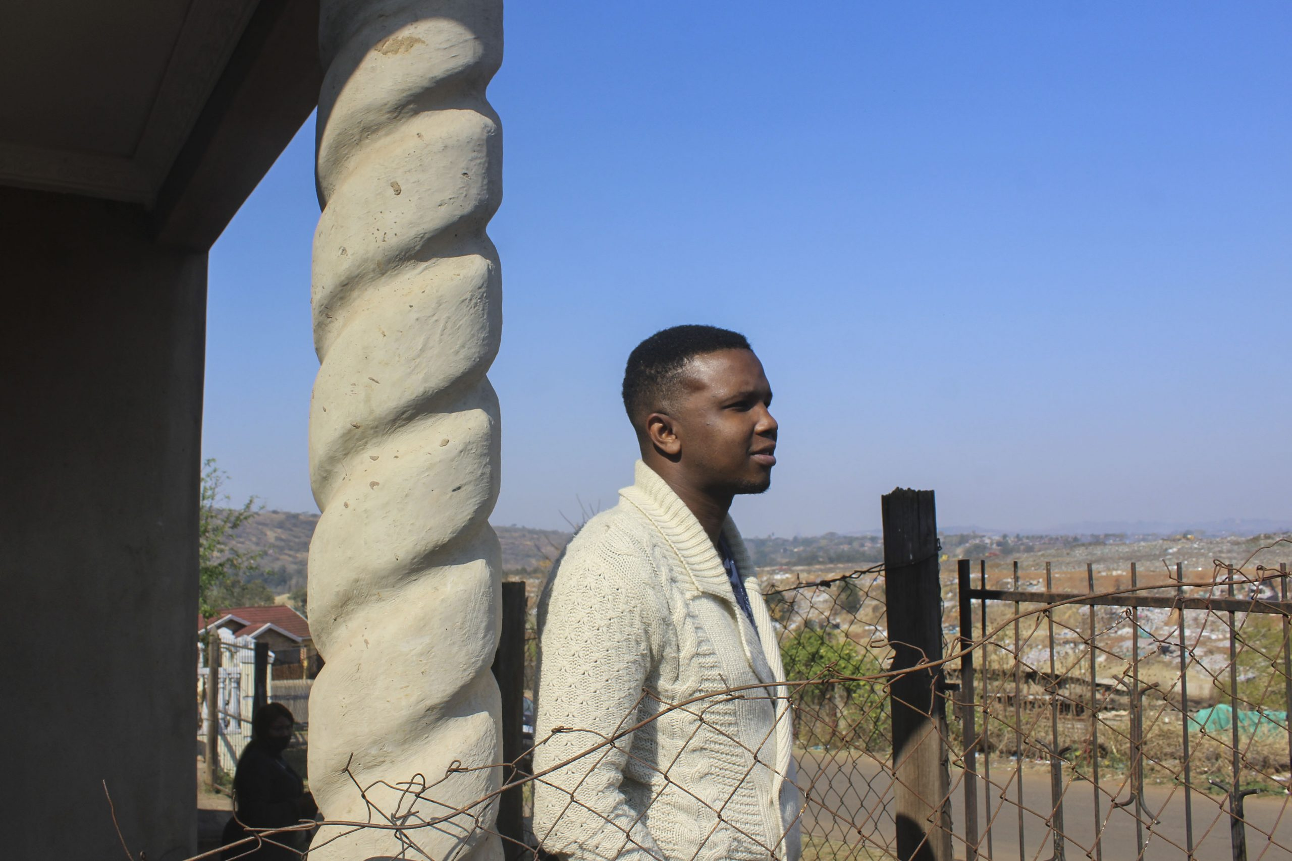28 July 2020: For nearly 30 years, Collin Memela has watched the rubbish at Pietermaritzburg's main municipal dump pile up into a mountain in front of his house in Sobantu Village. (Photograph by Tony Carnie)